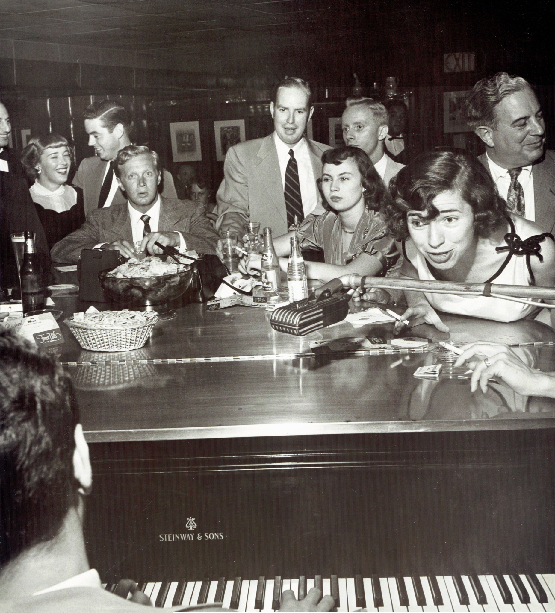 1953 Roger working at a piano bar as 'Louie Weertz'