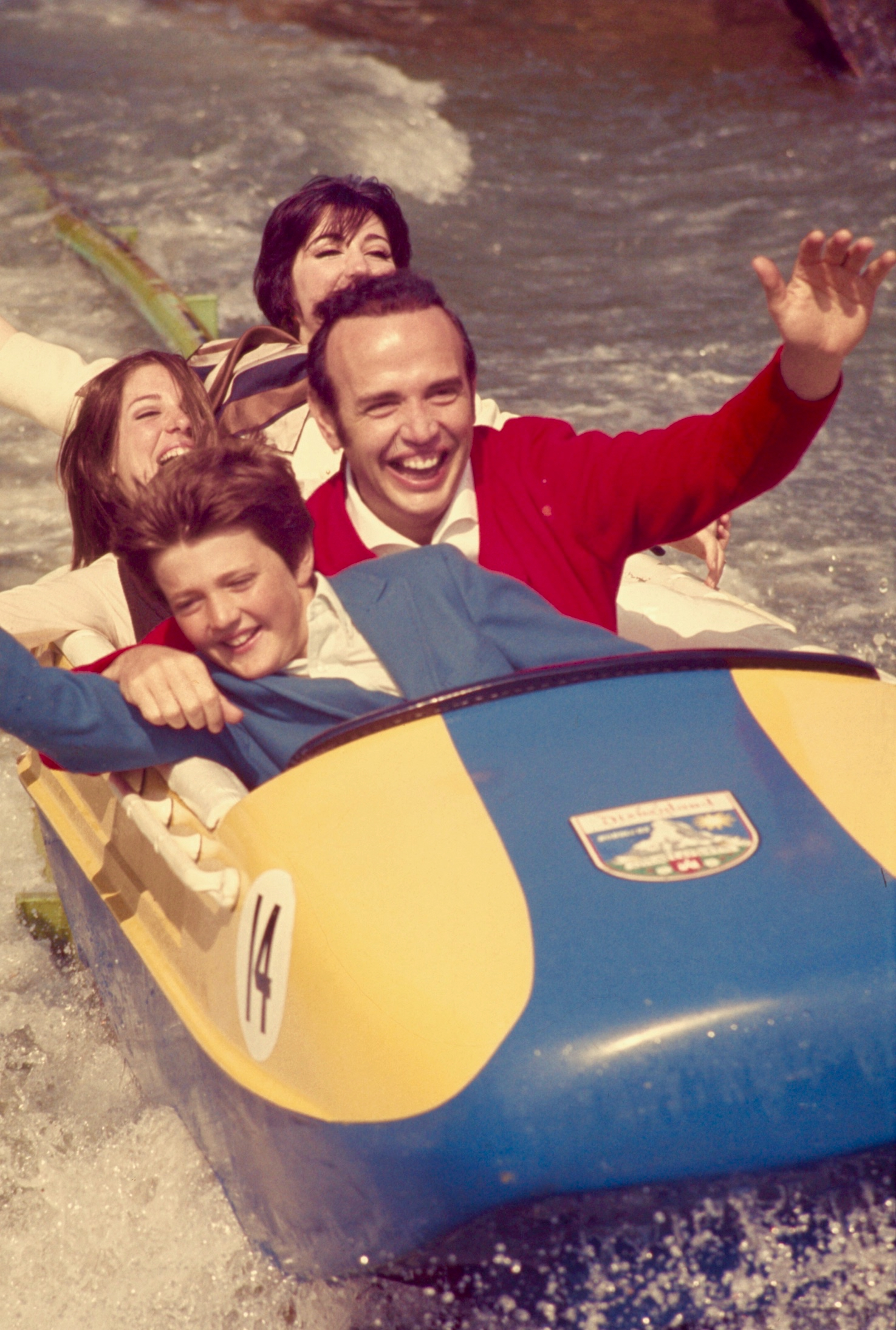 Disneyland bobsleds with Roger and his children, Laura, Alice, and Jim