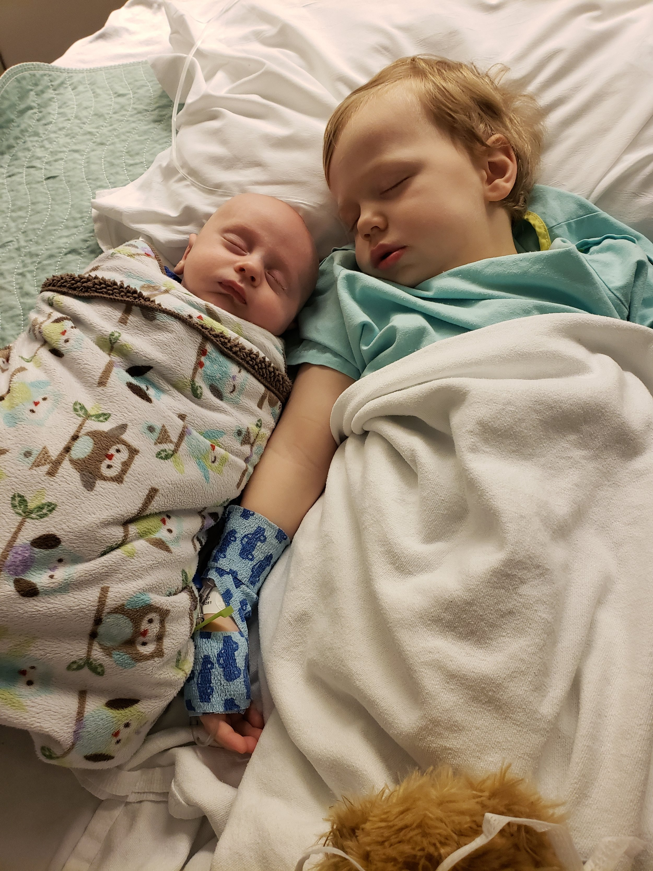 Cameron and Braden share a nap after Cameron's hernia surgery.
