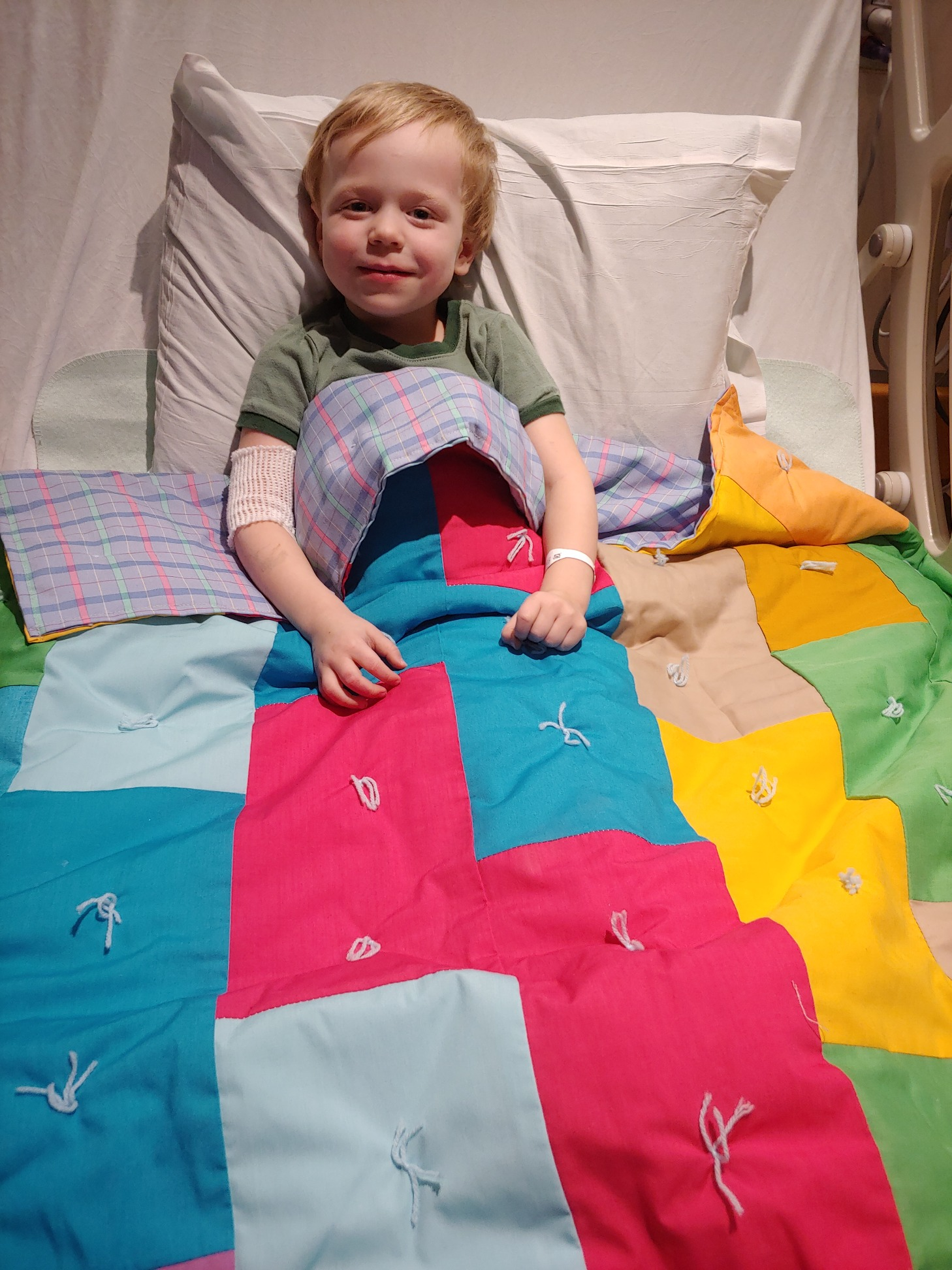 Cameron back in Regina, ready for bed with his special quilt from Ronald McDonald House in Saskatoon.