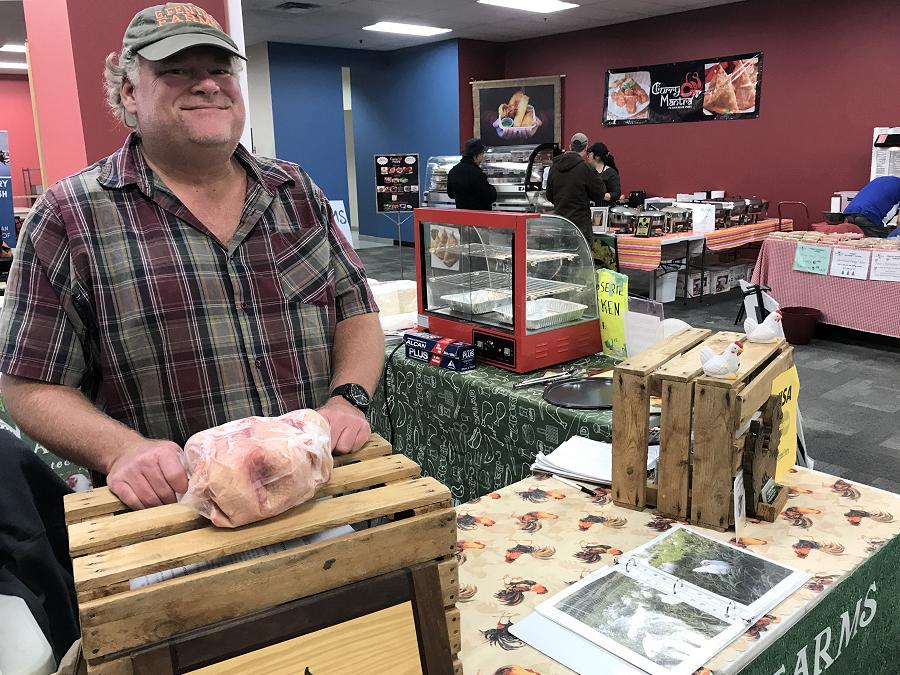 Gary Fenton enjoys the winter location of the Peterborough Regional Farmers' Market. He cooked his rotisserie chickens in the loading bay at Peterborough Square and enjoyed the crowds looking for fresh and frozen birds. (Photo: Barb Shaw / kawarthaNOW.com)