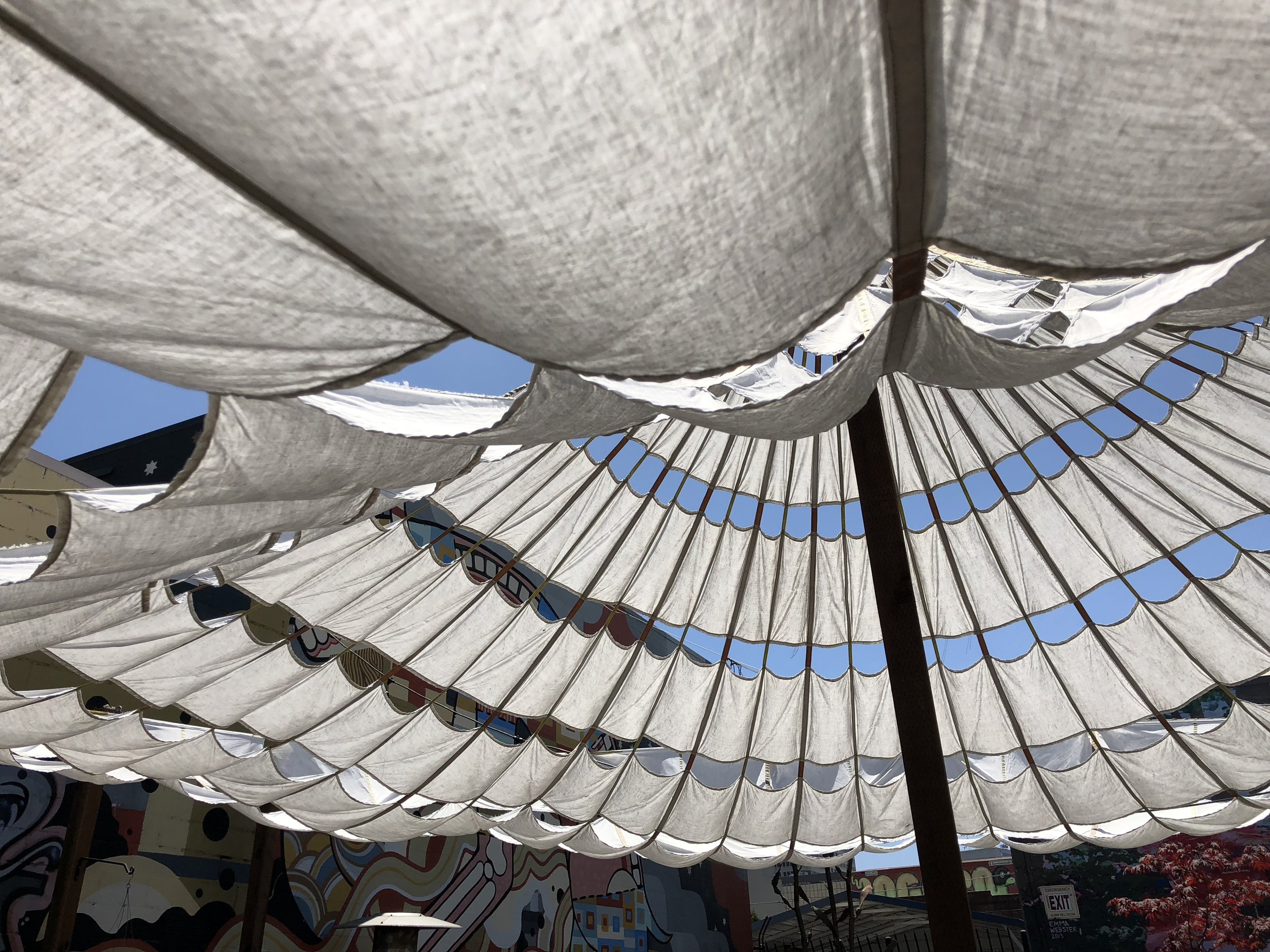 The parachute umbrella billowing in the breeze....