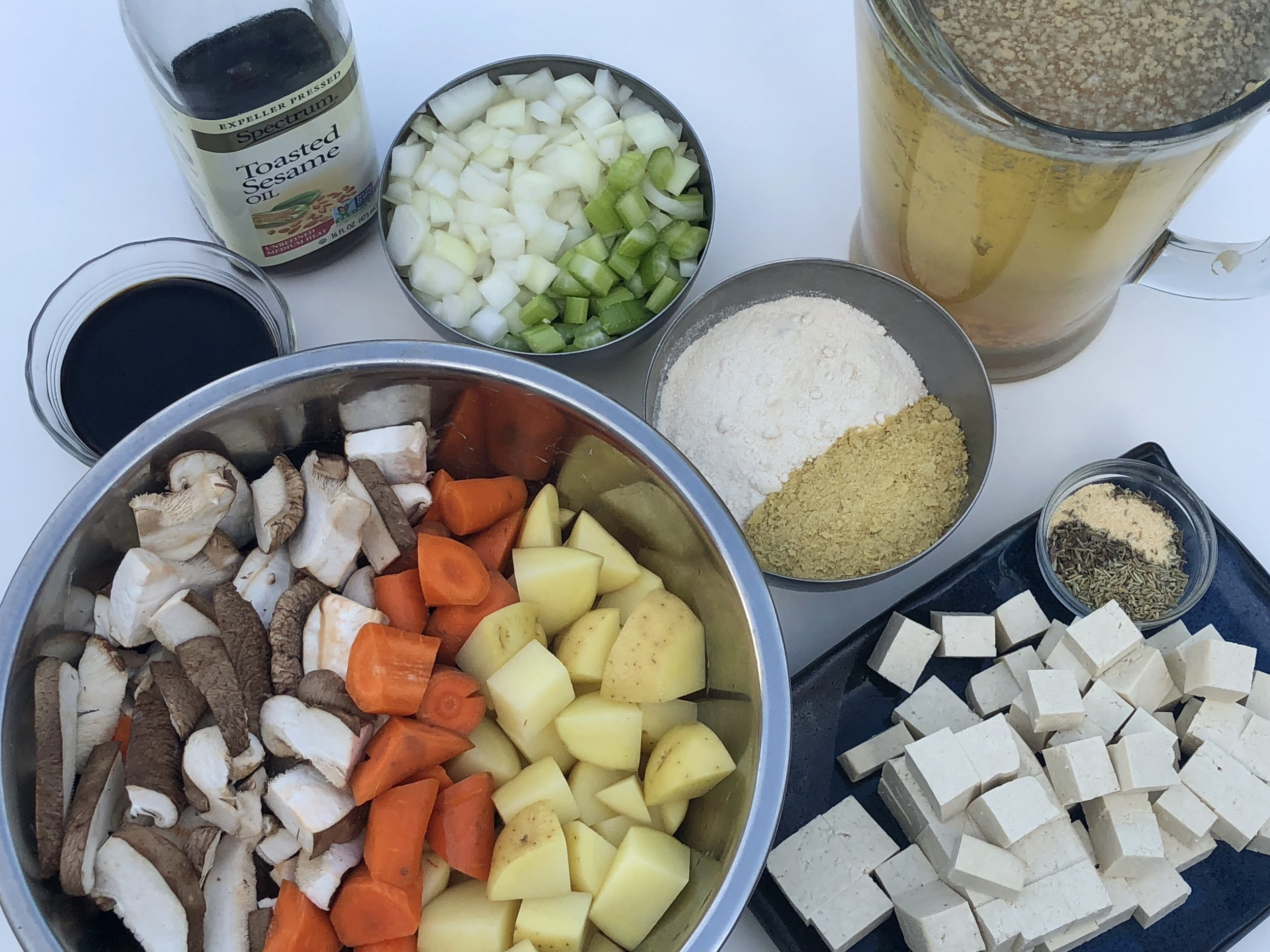Mise en place-everting in it's place. Soy sauce & vinegar is at the top left, sesame oil, onion & celery, vegetable broth, flour & nooch, spices, cubed tofu, the chopped veggies.