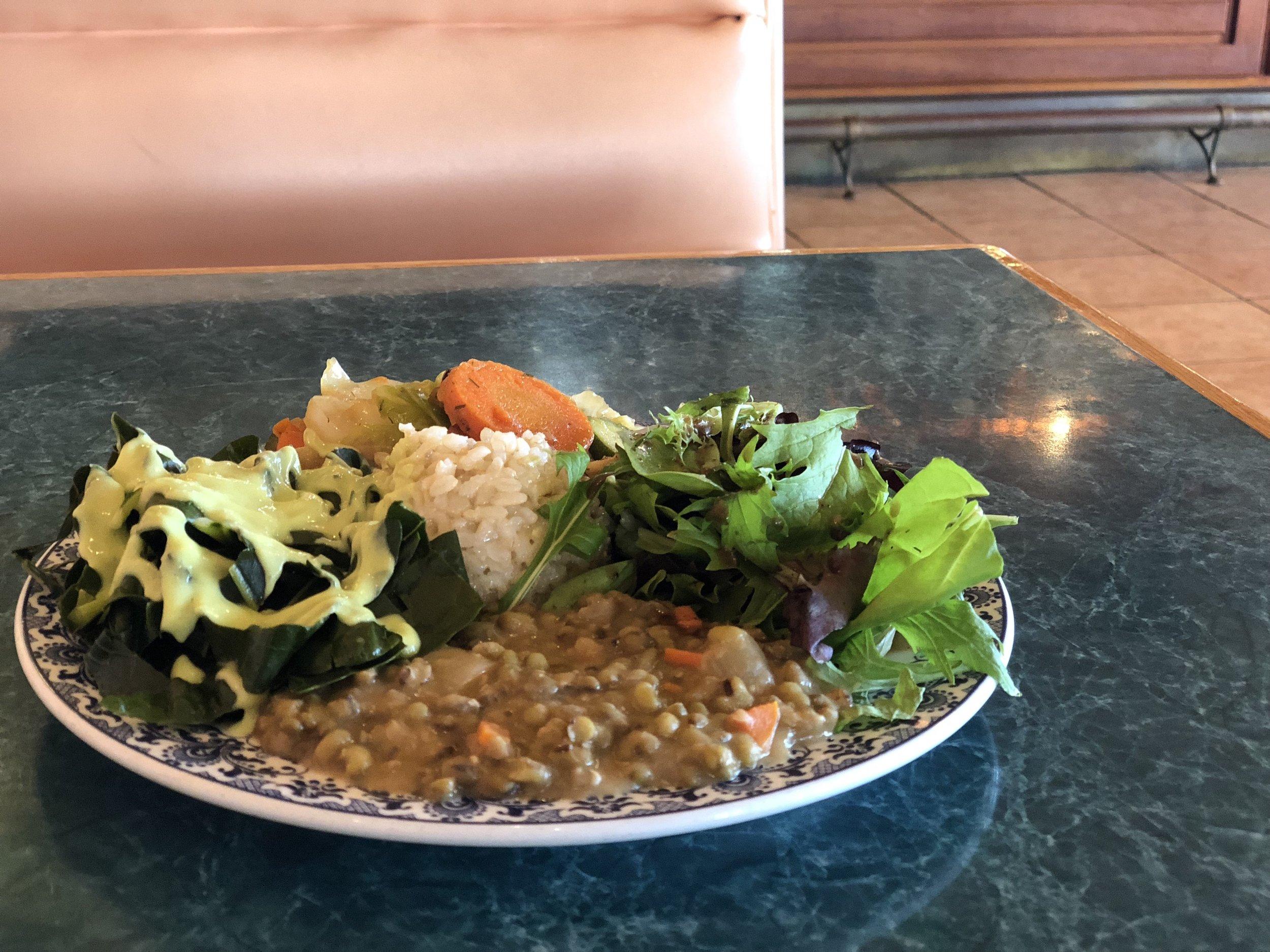 brown rice, mung bean w/onions, sautéed green cabbage, zucchini, carrot & potato, steamed collards with tofu-avocado sauce, mixed green salad