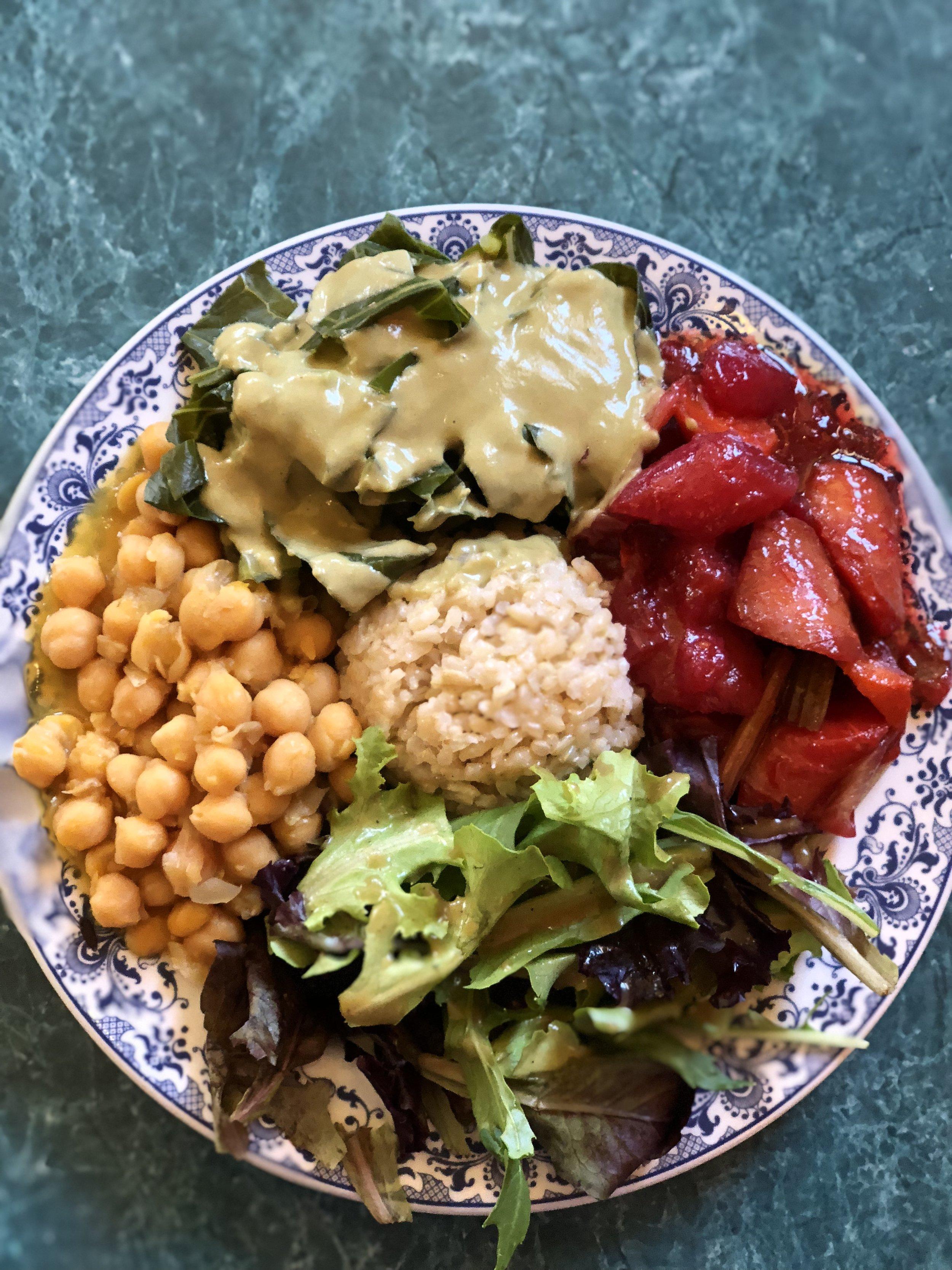 brown rice, garbanzo beans with onion & squash, sautéed carrot, celery, beet & daikon, steamed collards with leek sauce, & green salad
