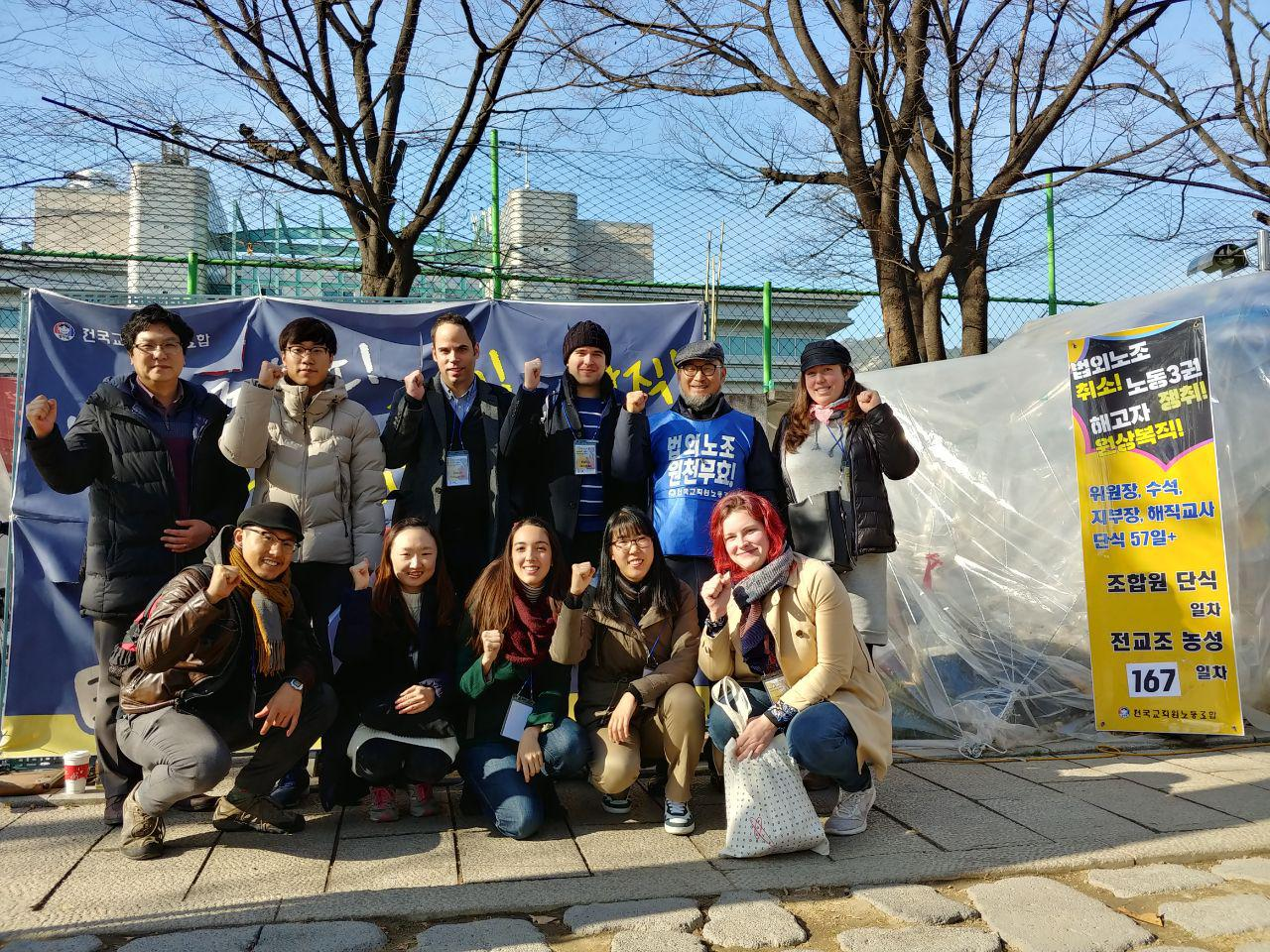 (Participants and KTU President next to the occupation tent)