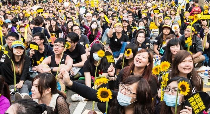 Celebration of the 1-year anniversary of the Sunflower Movement on March of 2015.  Source:    http://www.asianews.it