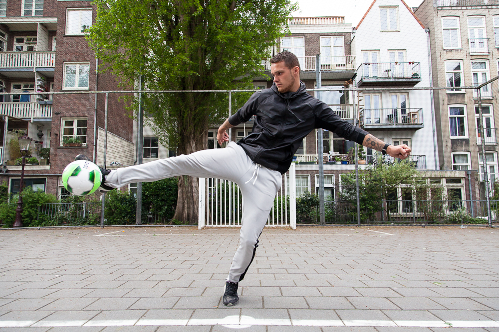 Niall Raben practices an akka at the Waag Court, the most central in Amsterdam. Niall plays non-league football on Saturdays as well as semi-professional futsal (hall football) on Fridays, but states he is most at home playing on the streets. He is known for his array of variations of the akka skill move. An akka is trick that comes from the Surinamese word meaning 'hook'.