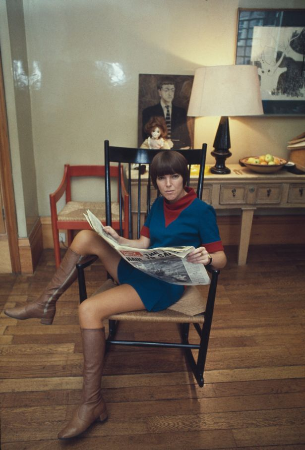 Mary Quant pictured reading the Daily Mirror newspaper in a rocking chair at home in London in 1967  (Image: Popperfoto/Getty Images)