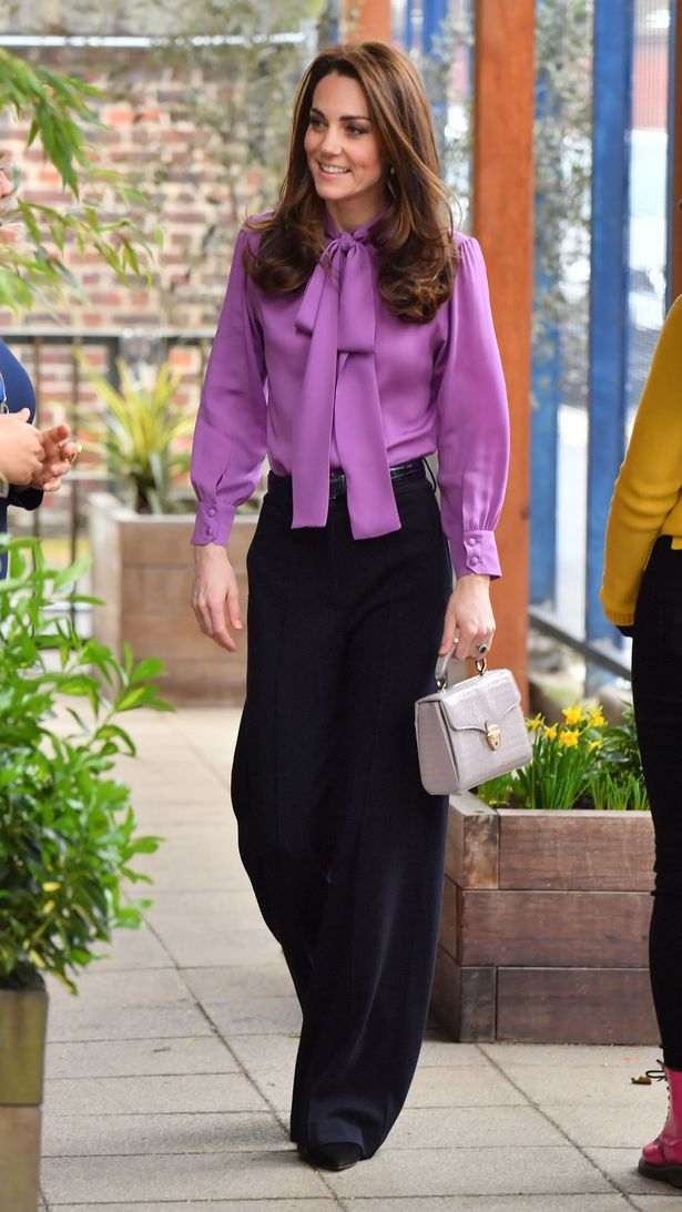 The Duchess of Cambridge wearing a Gucci blouse and Jigsaw trousers during a visit to the Henry Fawcett Children's Centre (Image: PA)