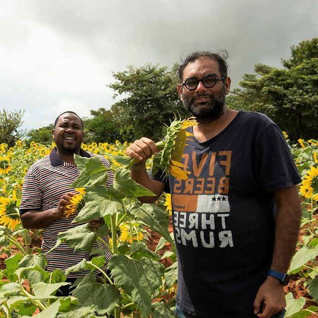Chef @gaggan_anand (right) pictured with a @Farm_Africa project officer who is helping Tanzanian farmers to trial the use of a new type of sunflower seed that is more drought-tolerant and produces larger sunflower heads with higher yields of seeds. 🌻🌻🌻 Photo: @elizapowellphotography #Worlds50Best #ChefsForChange #FarmAfrica #Gaggan #Tanzania #Sunflower #Sunflowers #Farming #Sustainability