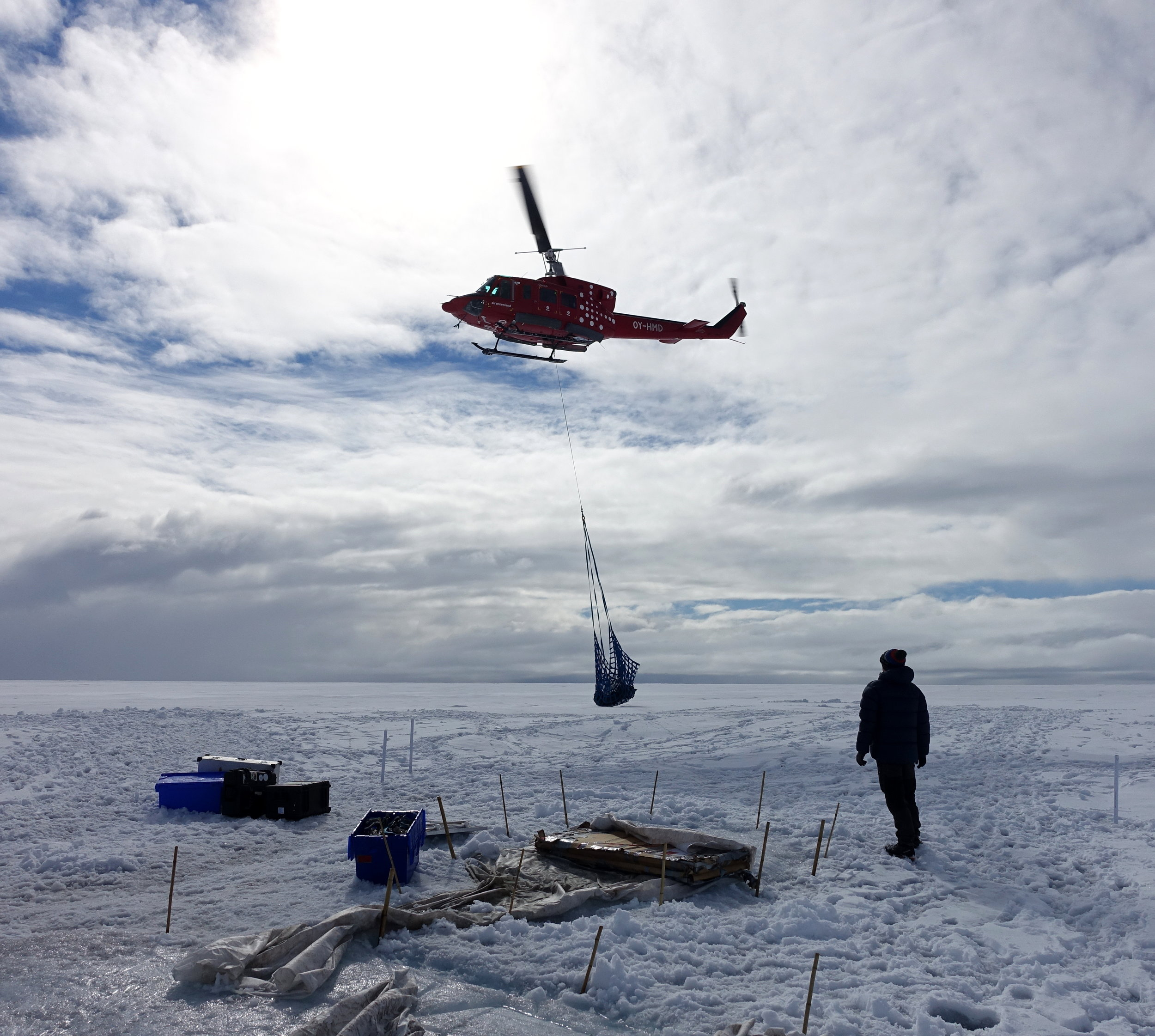 Air Greenland Bell 212 helicopter sling loading the team's equipment (ph J Cook)