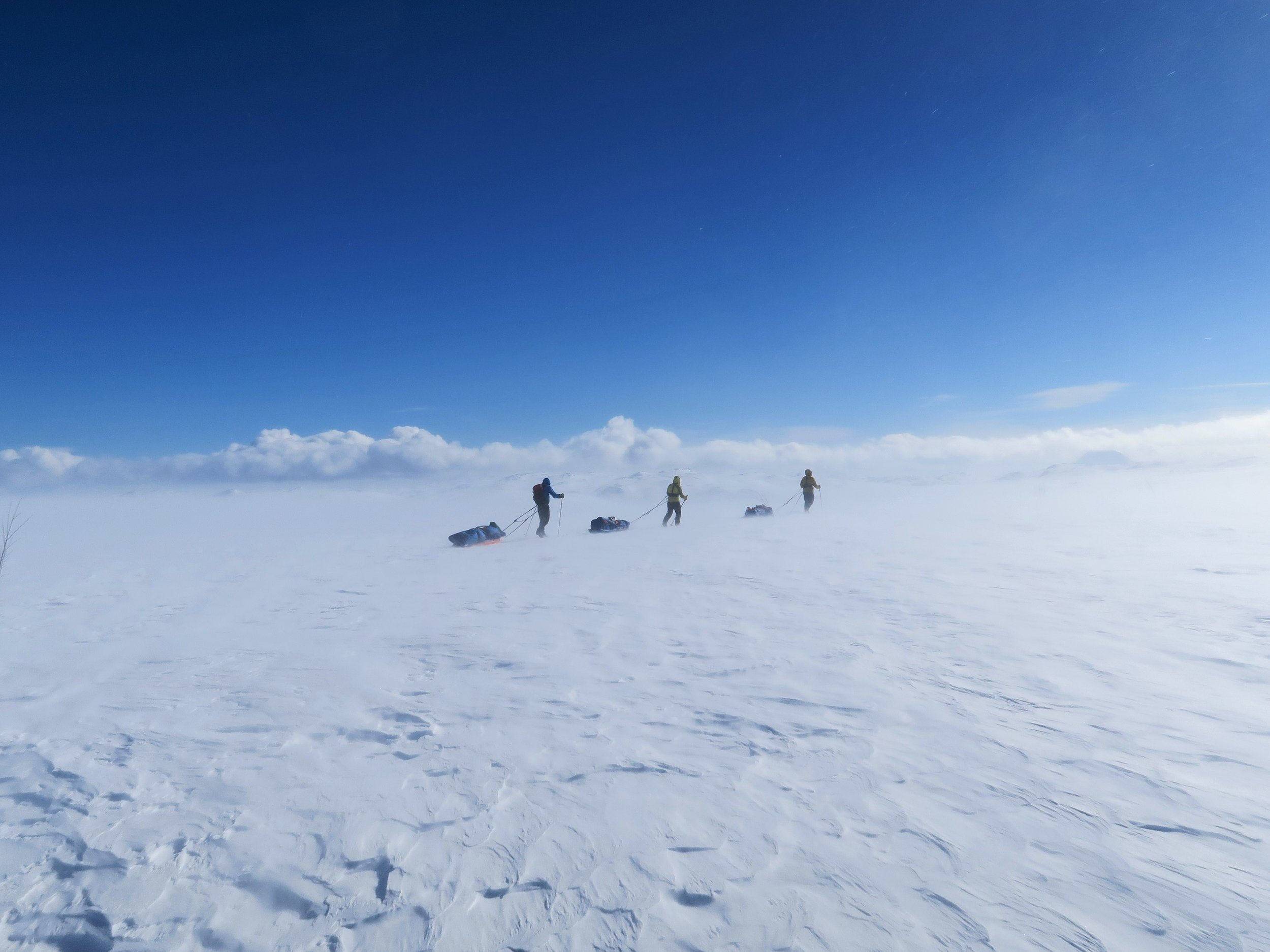 Team of three crossing the Hardangervidda Plateau, Norway in preparation