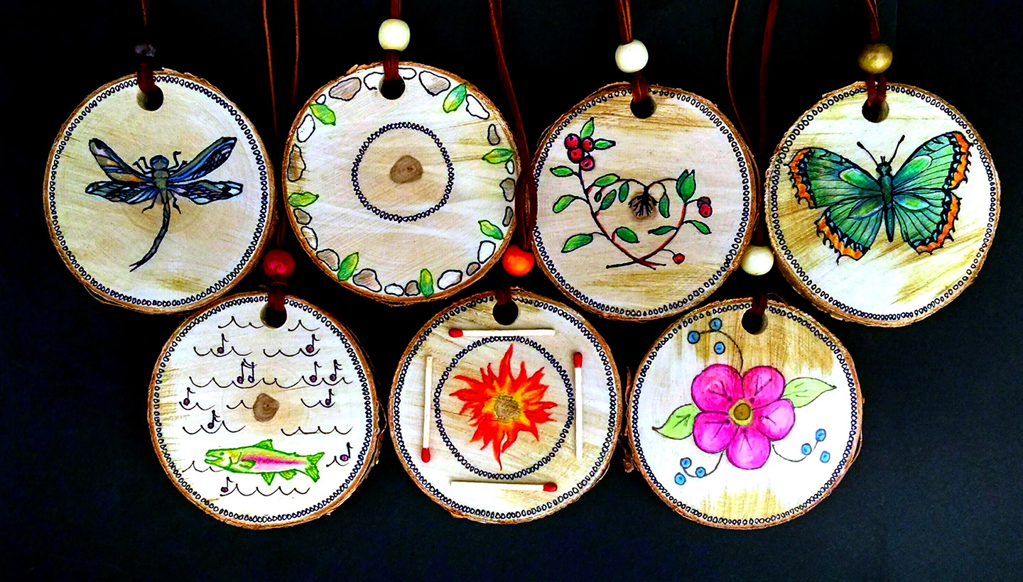 Medallions given to participants at the end of camp, honoring each child's strengths. Birch wood rounds, Prismacolor, ink pen, found objects.