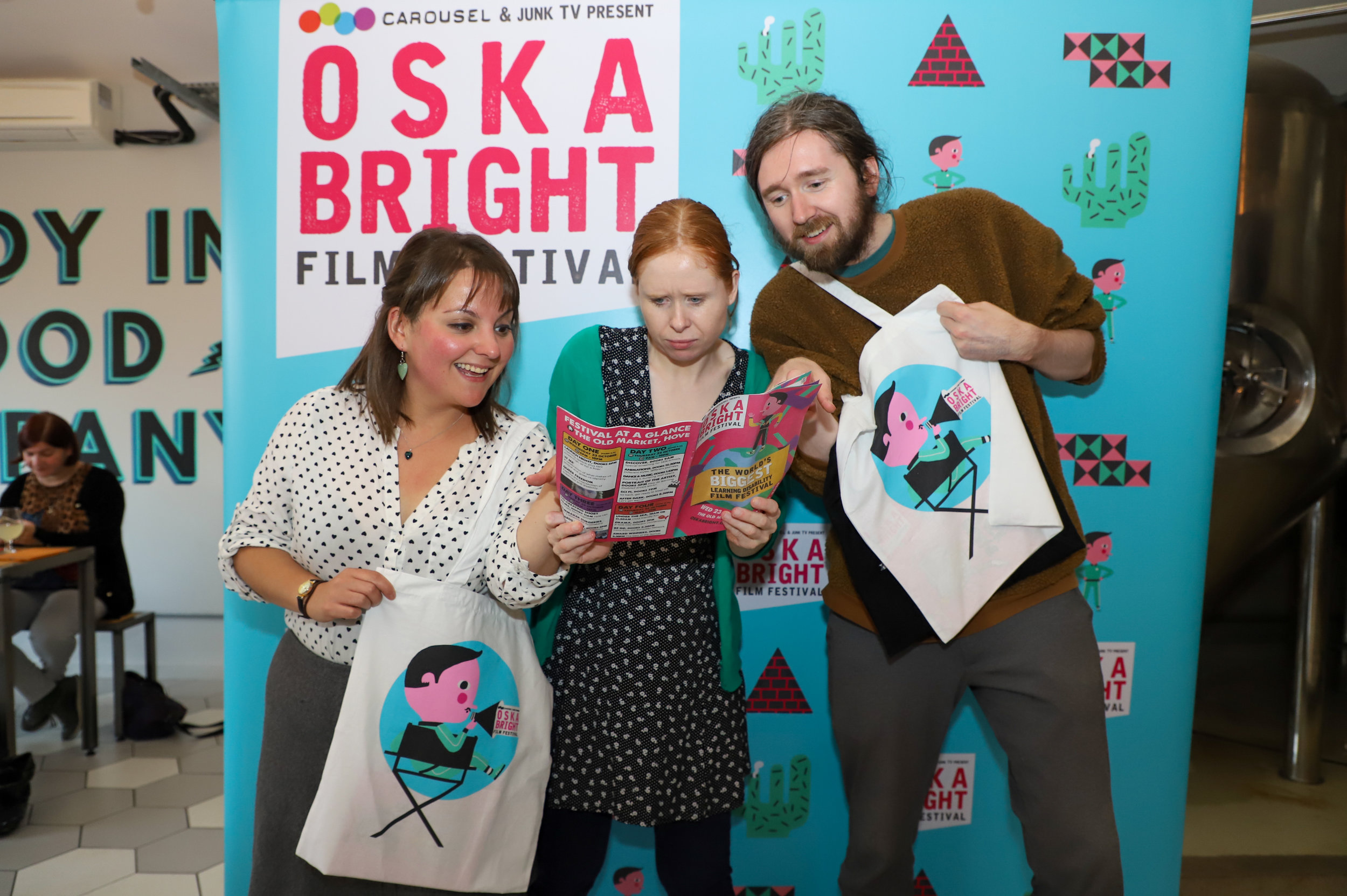 Laura and Andy from The Old Market read the Oska Bright Film Festival programme with Sarah Watson
