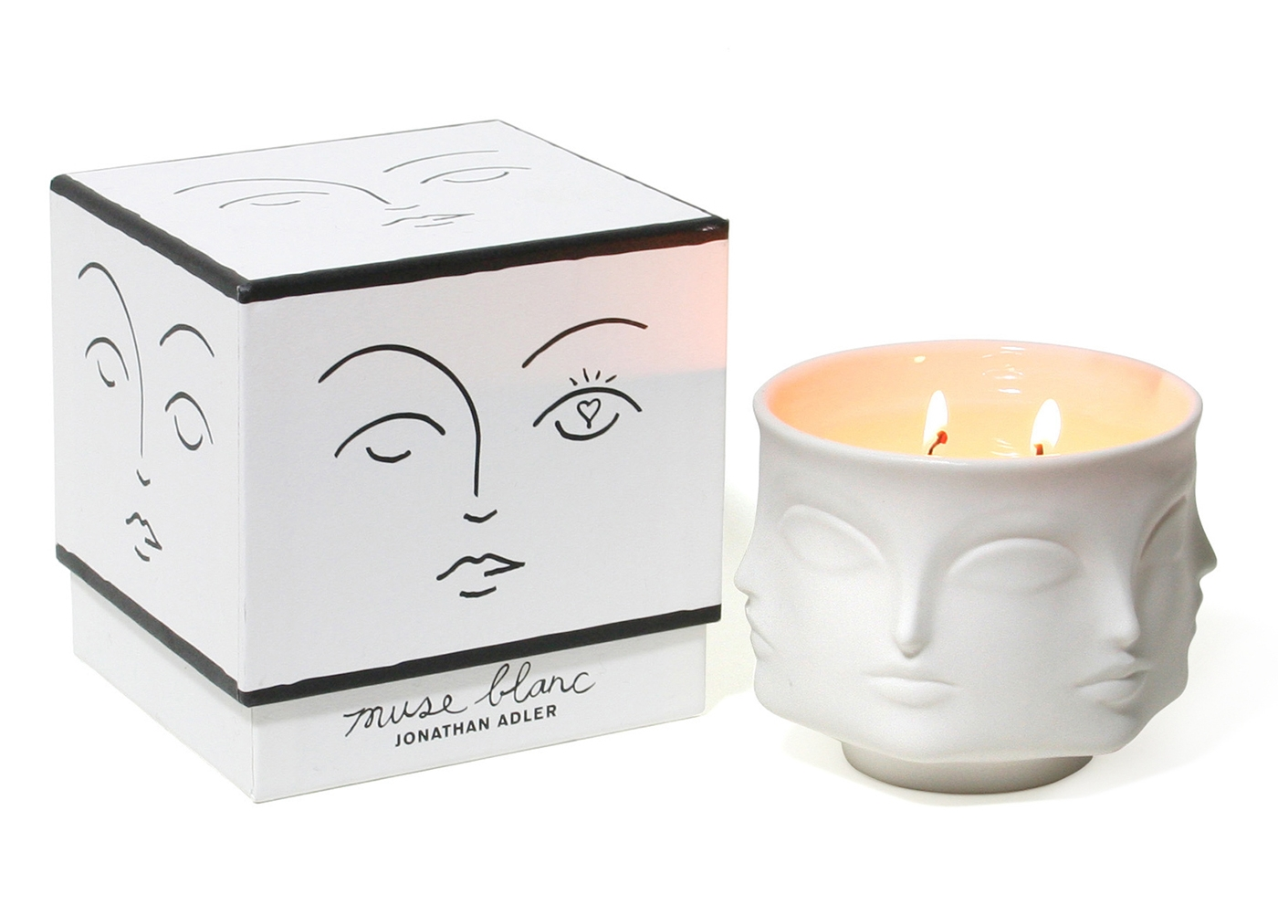 Jonathan Adler, Muse blanc ceramic candle , $78  When this crisp, floral candle burns out, I'm going to repurpose it as a vase. Two gifts for the price of one!