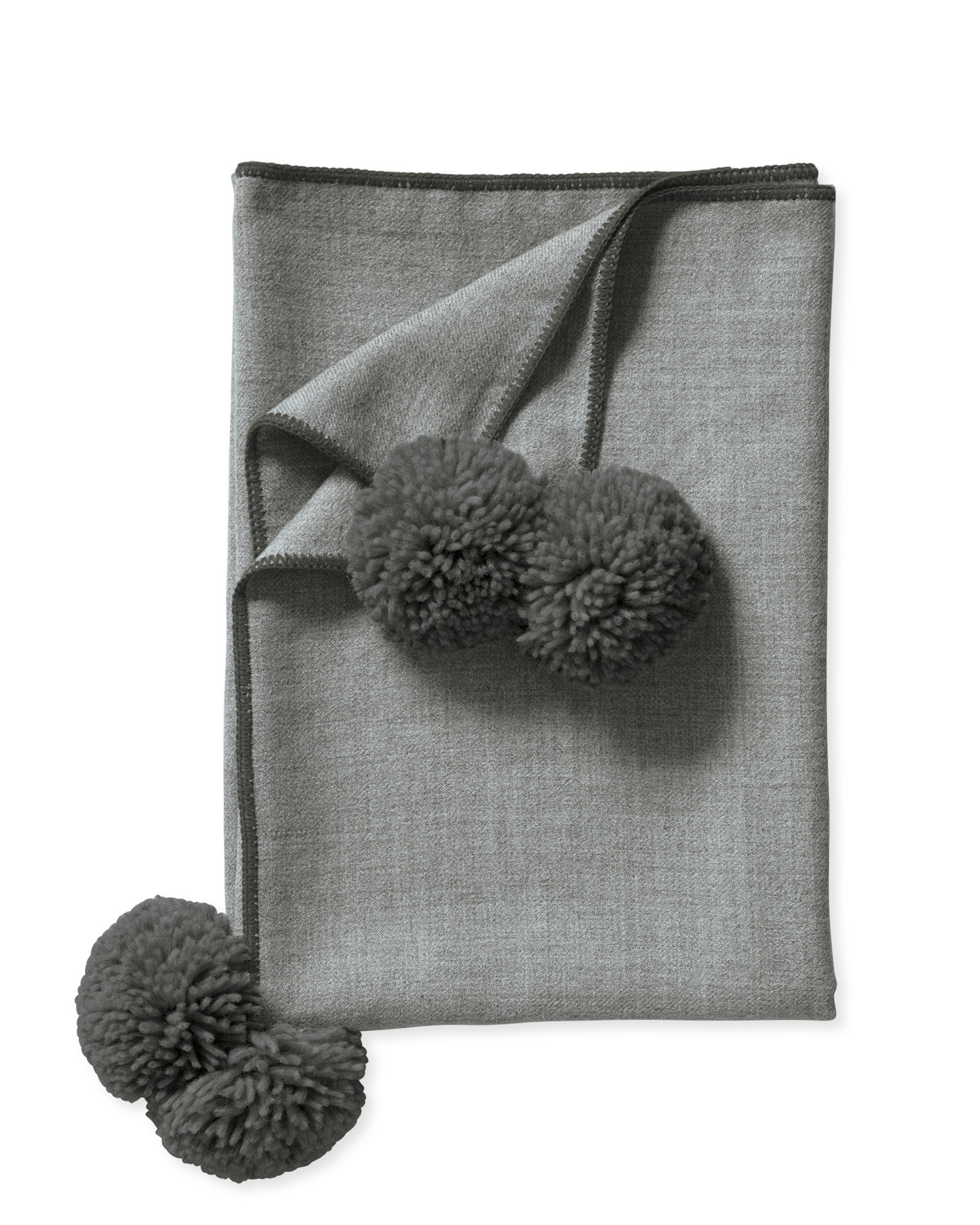 Alpaca wool and oversized pom-poms. Need we say more?!