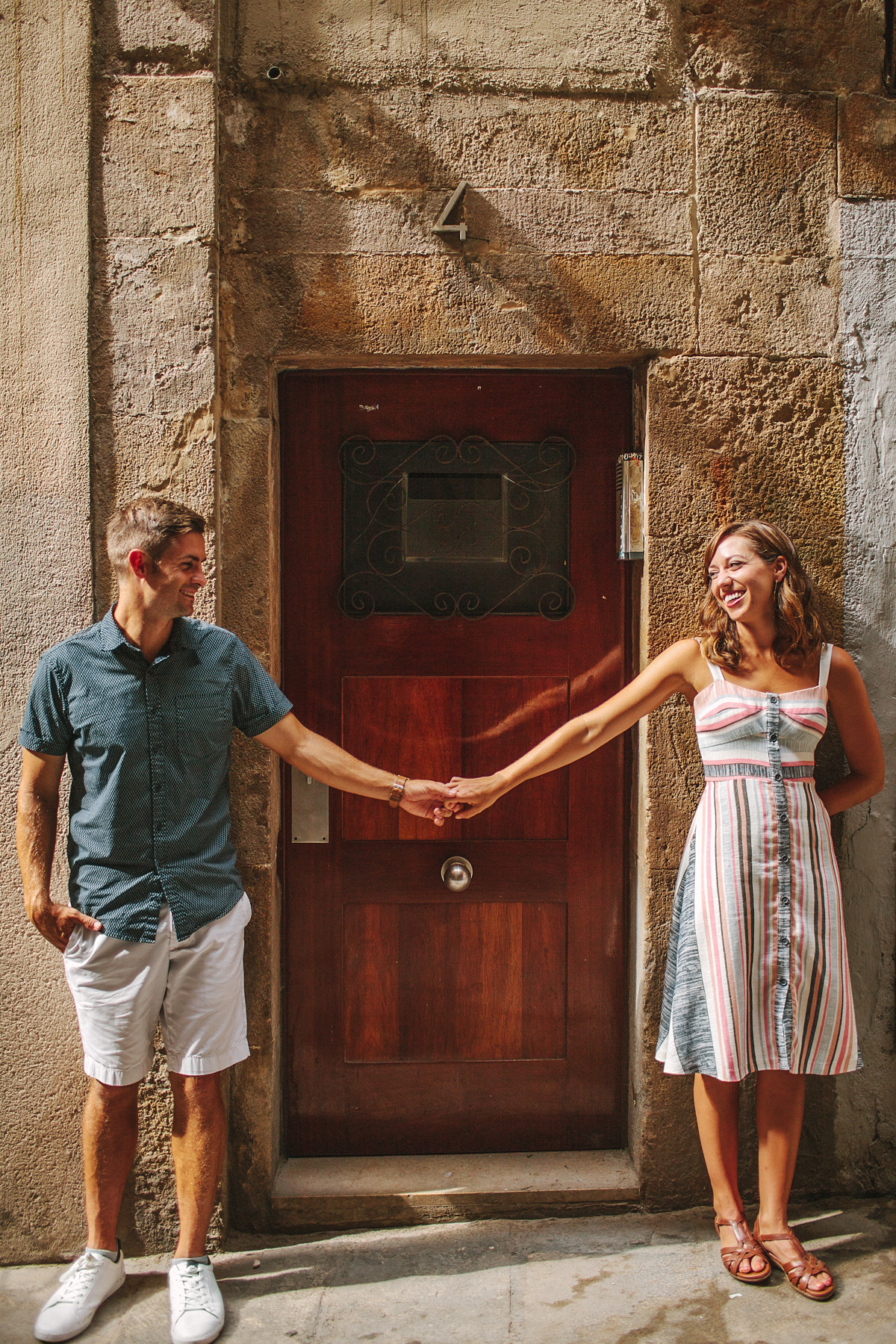 Copy of Couple holding hands standing in front of a door