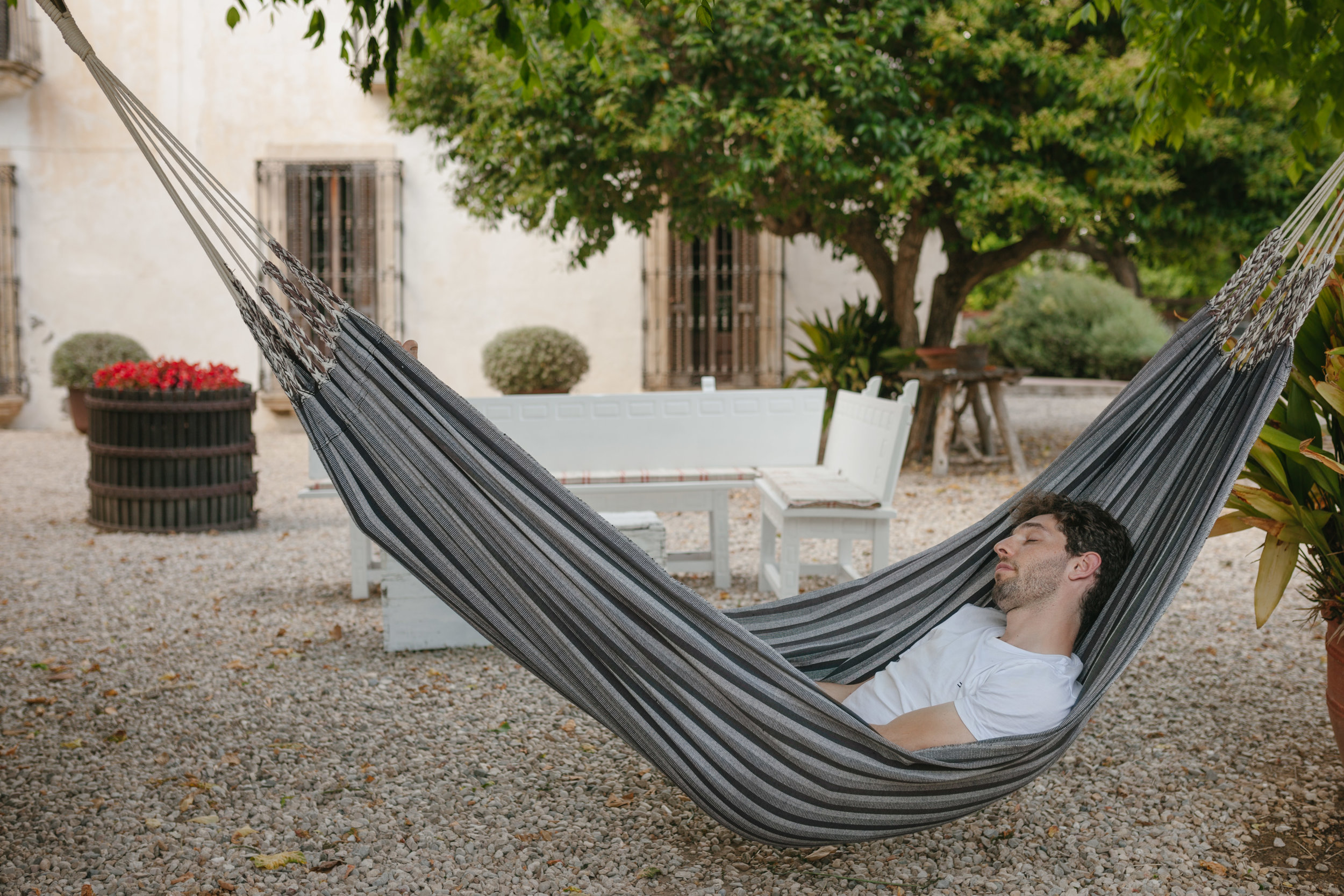 man sleeping on a hammock