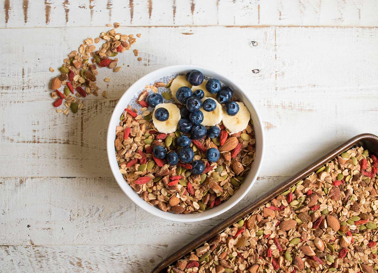 bowl of granola with blueberries and banana
