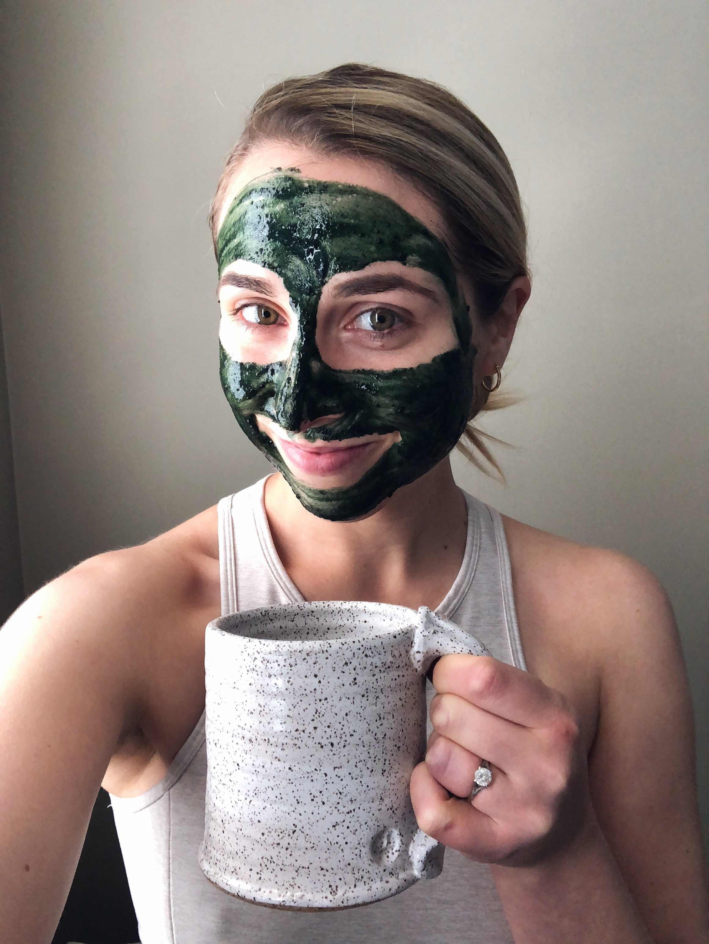 Girl with face mask on holding a mug