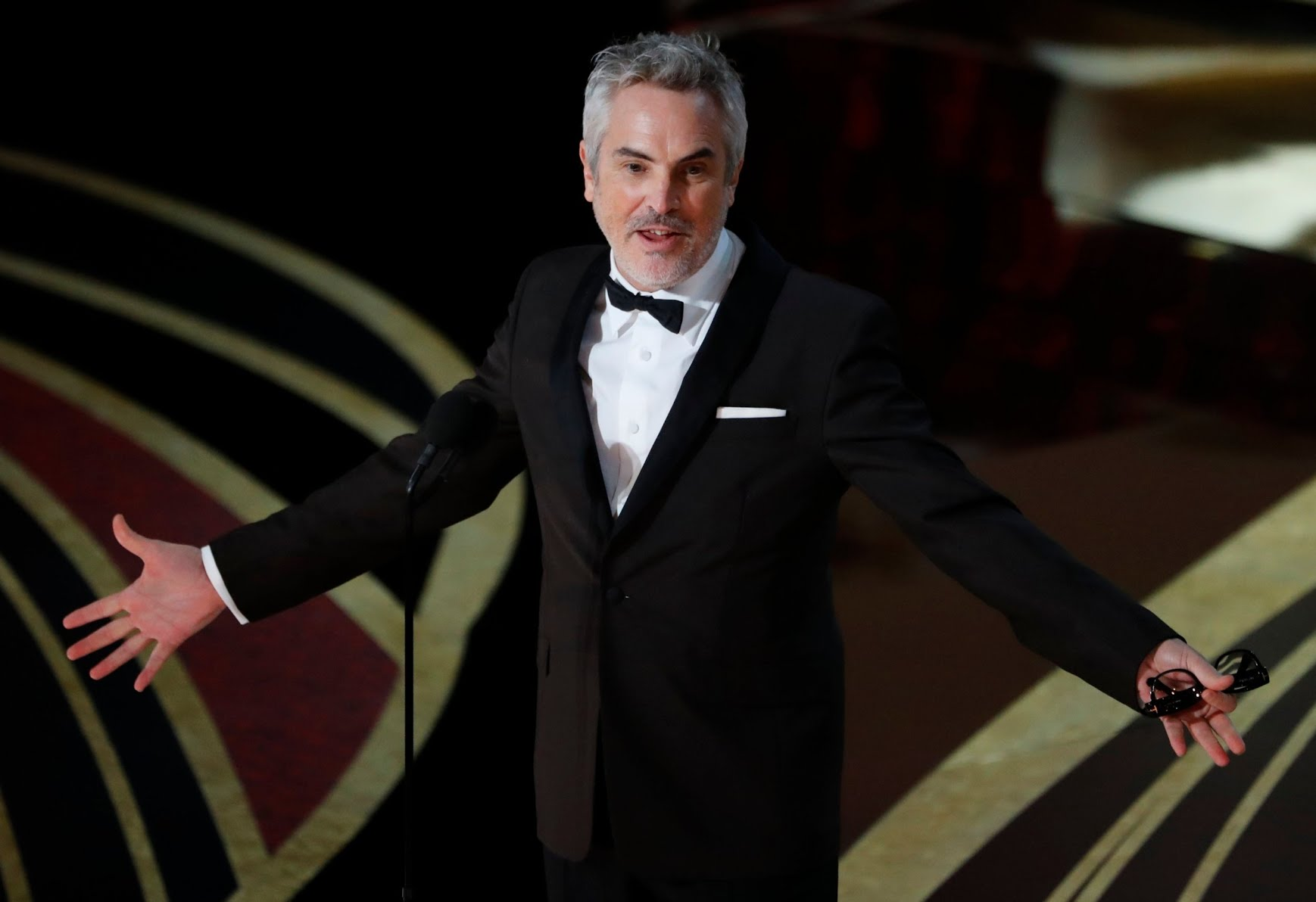 Alfonso Cuaron accepts the Best Director award for Roma