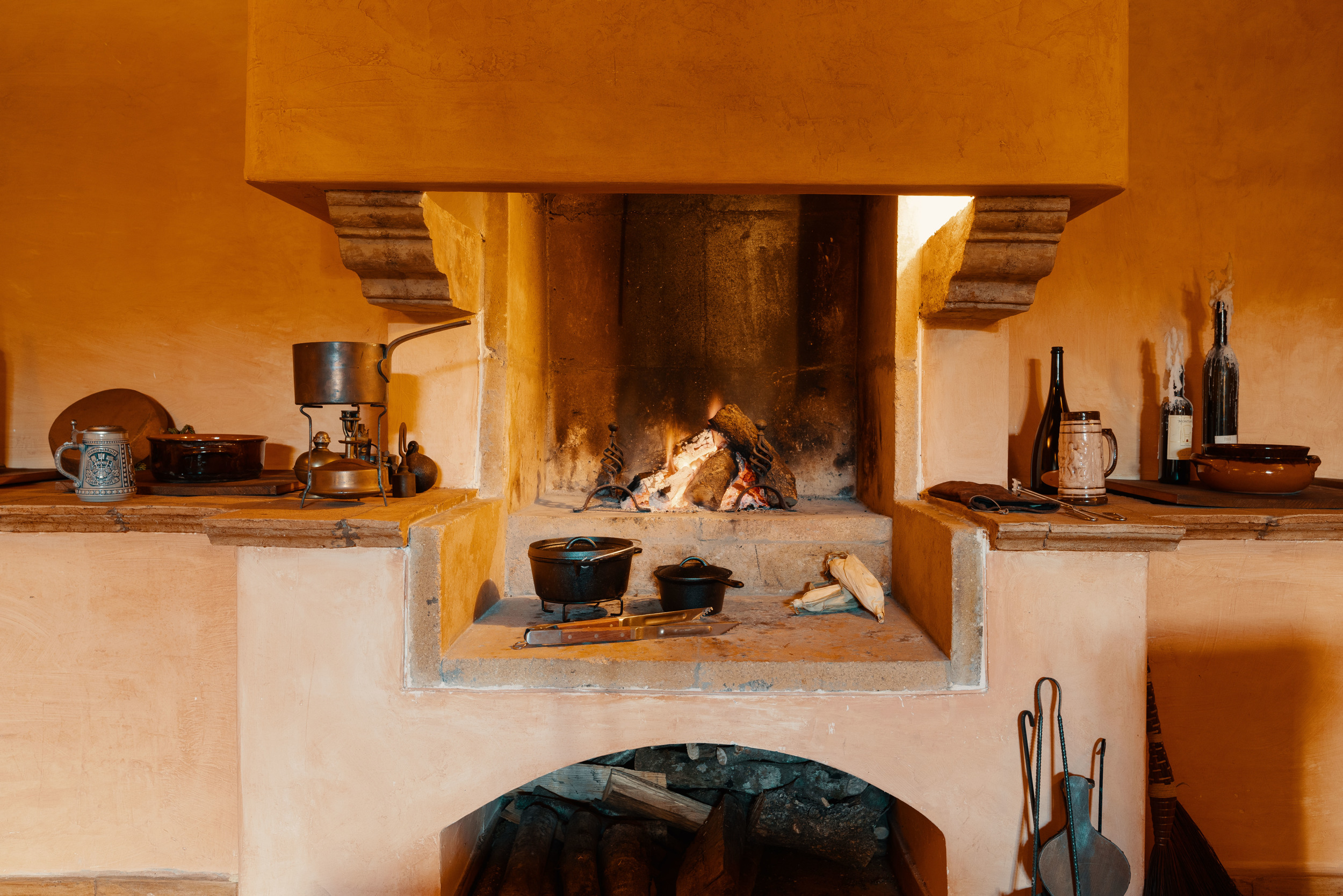 Wood-fired hearth and live-fire cooking.