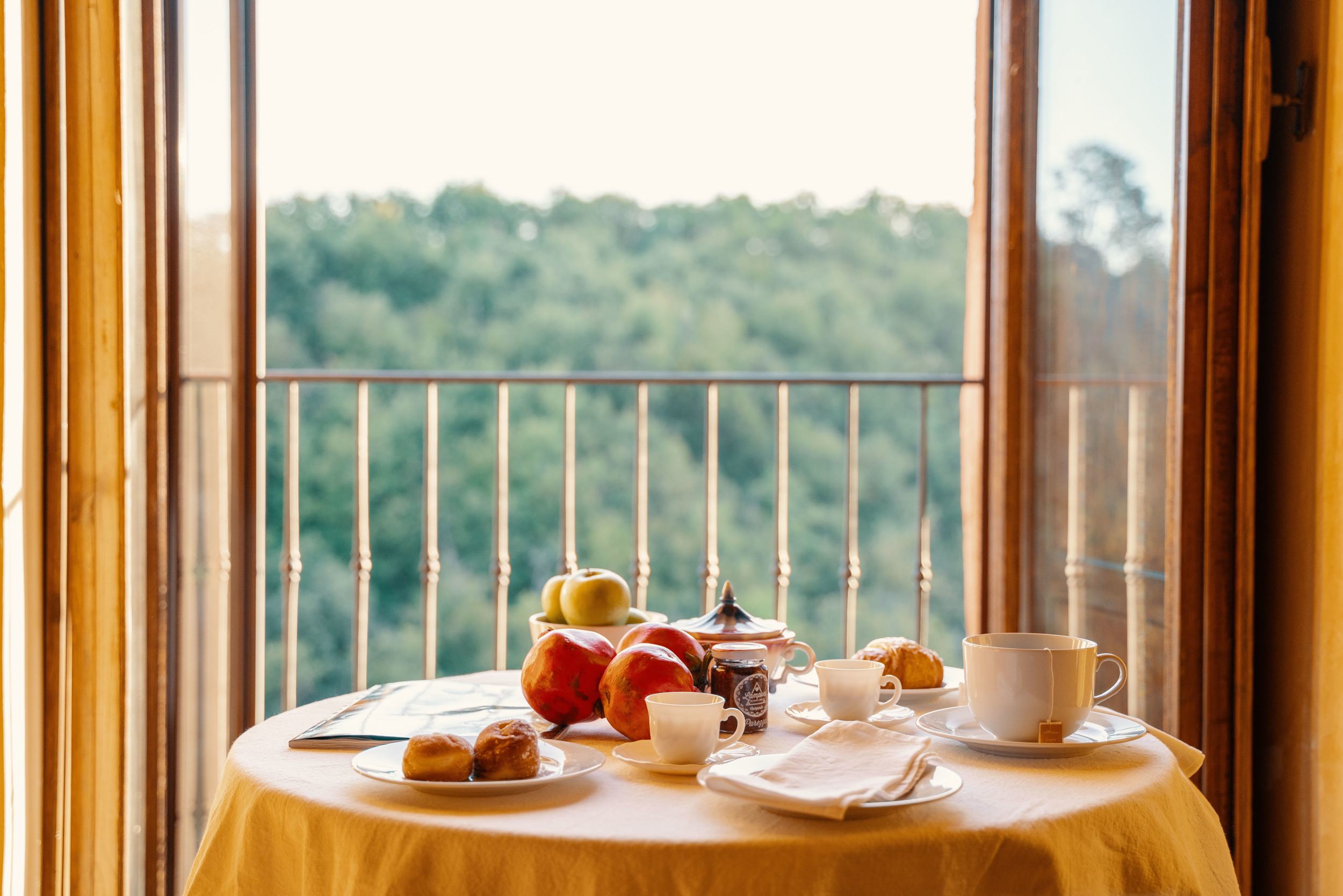 Breakfast table with chestnut forest view.