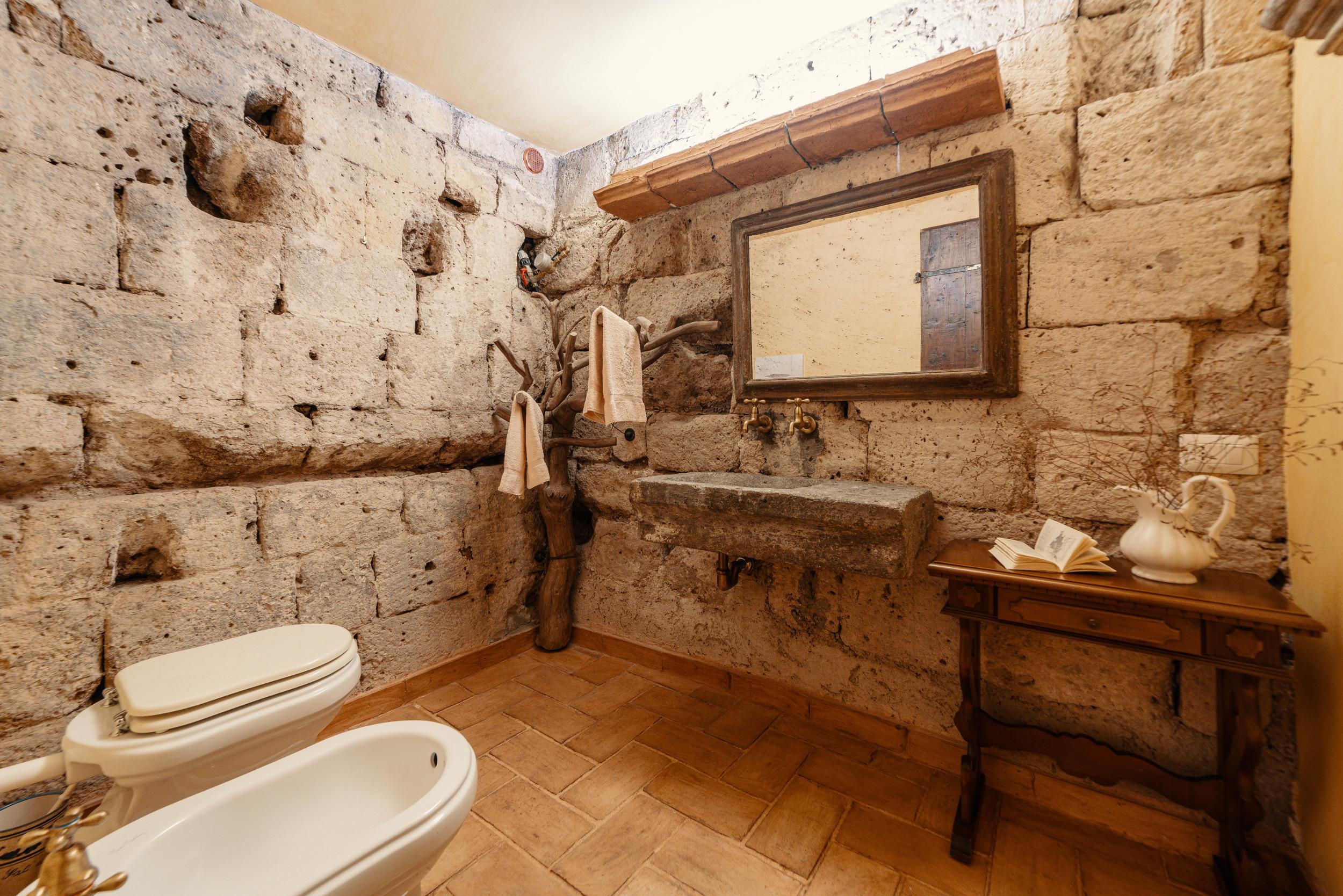 Bathroom with tufa rock walls.
