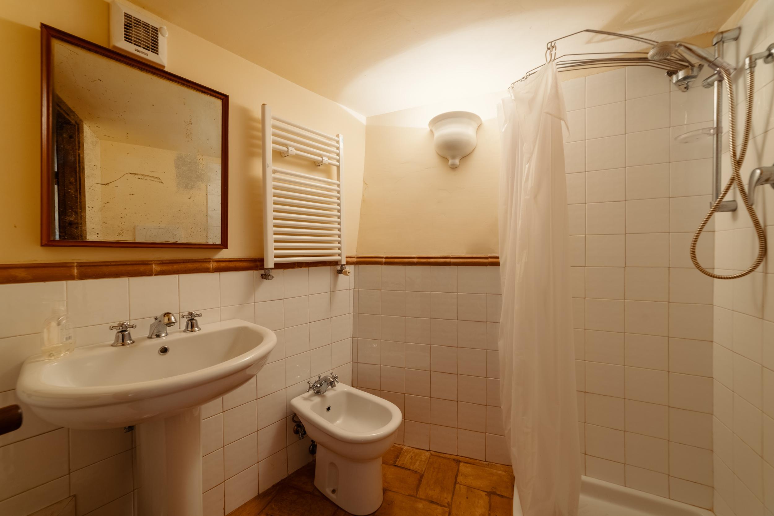 Underground bathroom with toilet, bidet and shower.