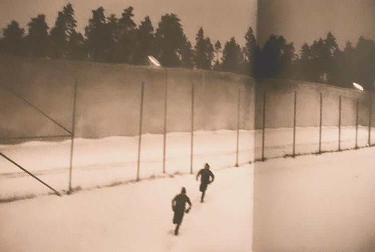 Two Men Running (Osteraker Prison 1980),  Petersen, Anders, et al.  Anders Petersen . Edited by Patric Leo, Bokförlaget Max Ström, 2013.