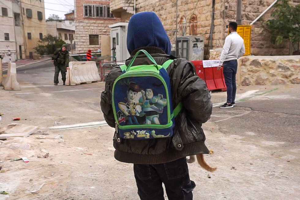 Boy and Kitten at Neighborhood Checkpoint, Hebron