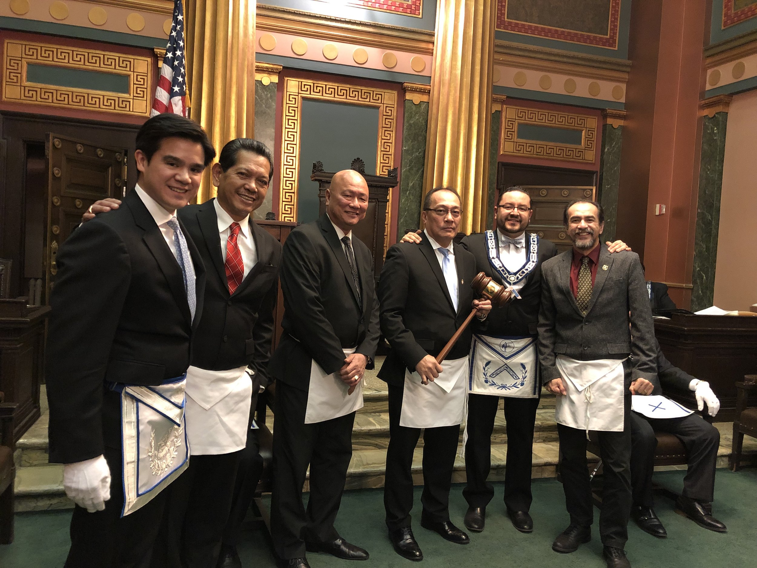 Columbian Lodge No. 484 takes the Traveling Gavel from Publicity Lodge No. 1000 on Monday, January 7, 2019. Where will the Gavel travel to next?   From L-R: WBro. Jeph Dais, Chaplain (Columbian 484); VWBro. Jojo Geronimo (Columbian 484), Trustee; RWBro. Adison Cruz, Member (Columbian 484); WBro. Violeto Palmere, Junior Warden (Columbian 484); WBro. Orlando Velez, Master (Publicity 1000); VWBro. Liberato Lao, Treasurer (Columbian 484).