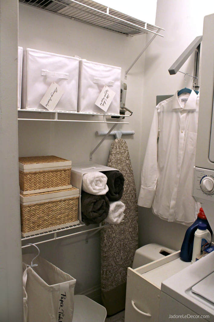 Space Saving Systems: Wall mounted iron holder, collapsible clothing rack, and slim rolling cart for laundry supplies and tool boxes