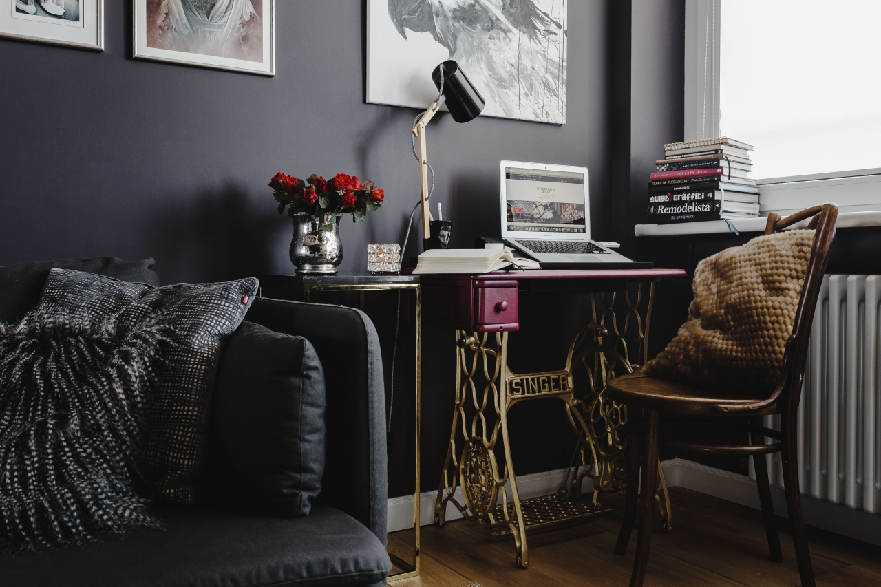 Pink desk in the home office with dark walls.jpg