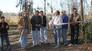 Cutting the Ribbon! Chris Bird, Alachua County Environmental Protection Director; Alachua Co. Commissioner Robert Hutchinson; Alachua Co. Commission Chair Mike Byerly; Alachua Co. Forever Program Manager Ramesh Buch; Alachua Co. Commissioner Lee Pinkoson, NRCS representative, and Interim Alachua Co. Manager Rick Drummond. Photo by Mark Sexton.