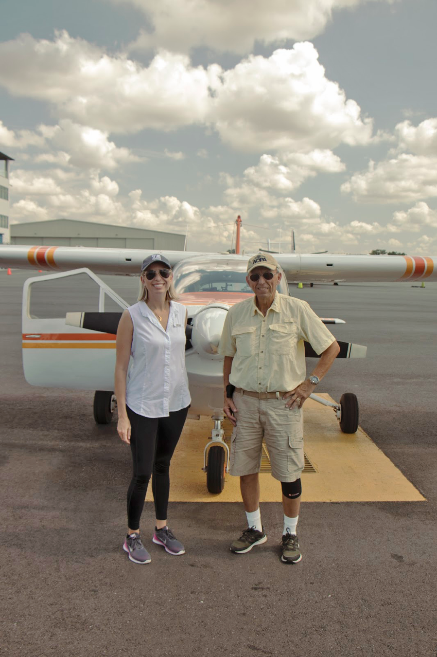 Traci Deen, Conservation Florida's executive director standing with pilot, Charlie Martinez on flight day.
