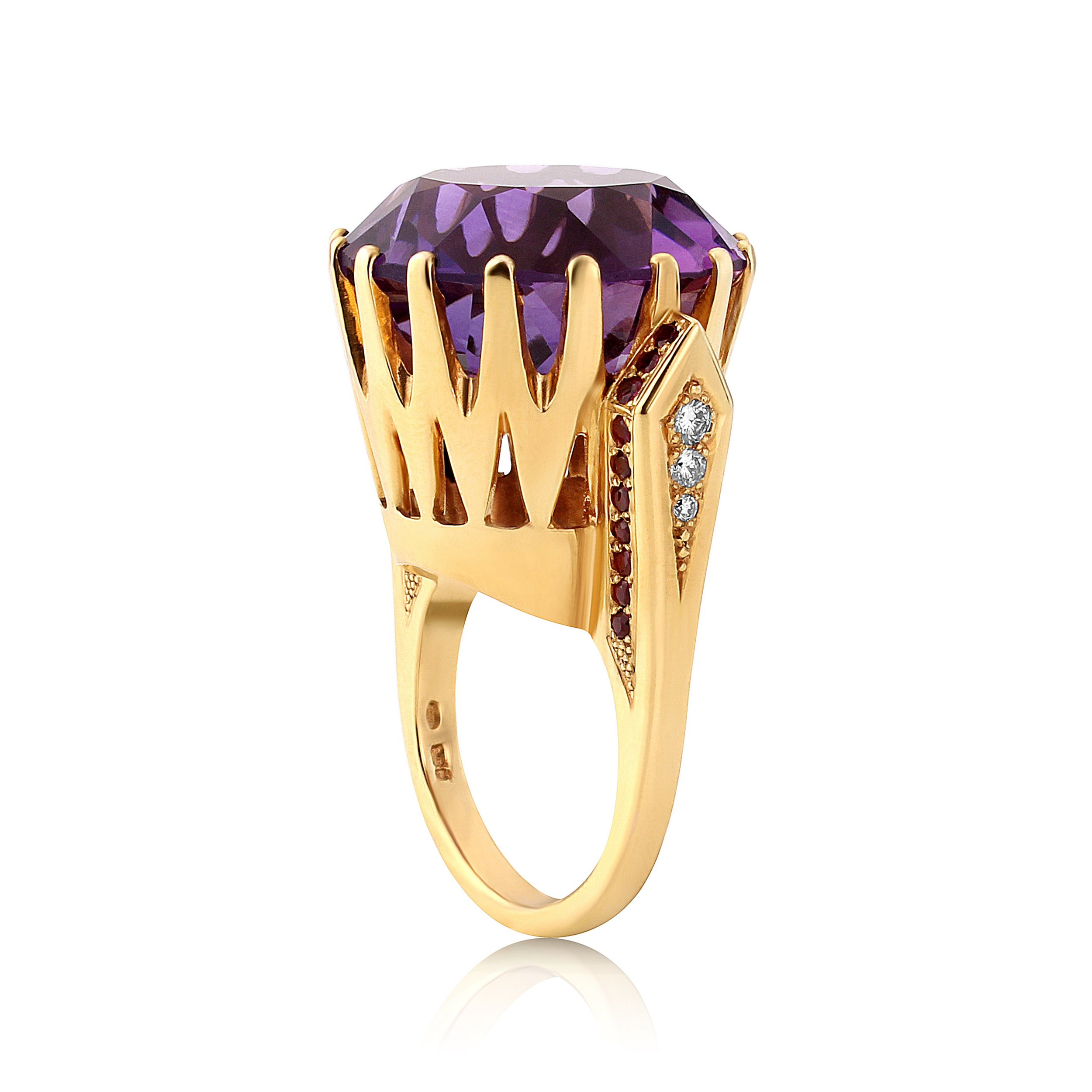 A stunning 36ct amethyst diamond and ruby ring in a over the top design ,this ring is a dress ring and not subtle1