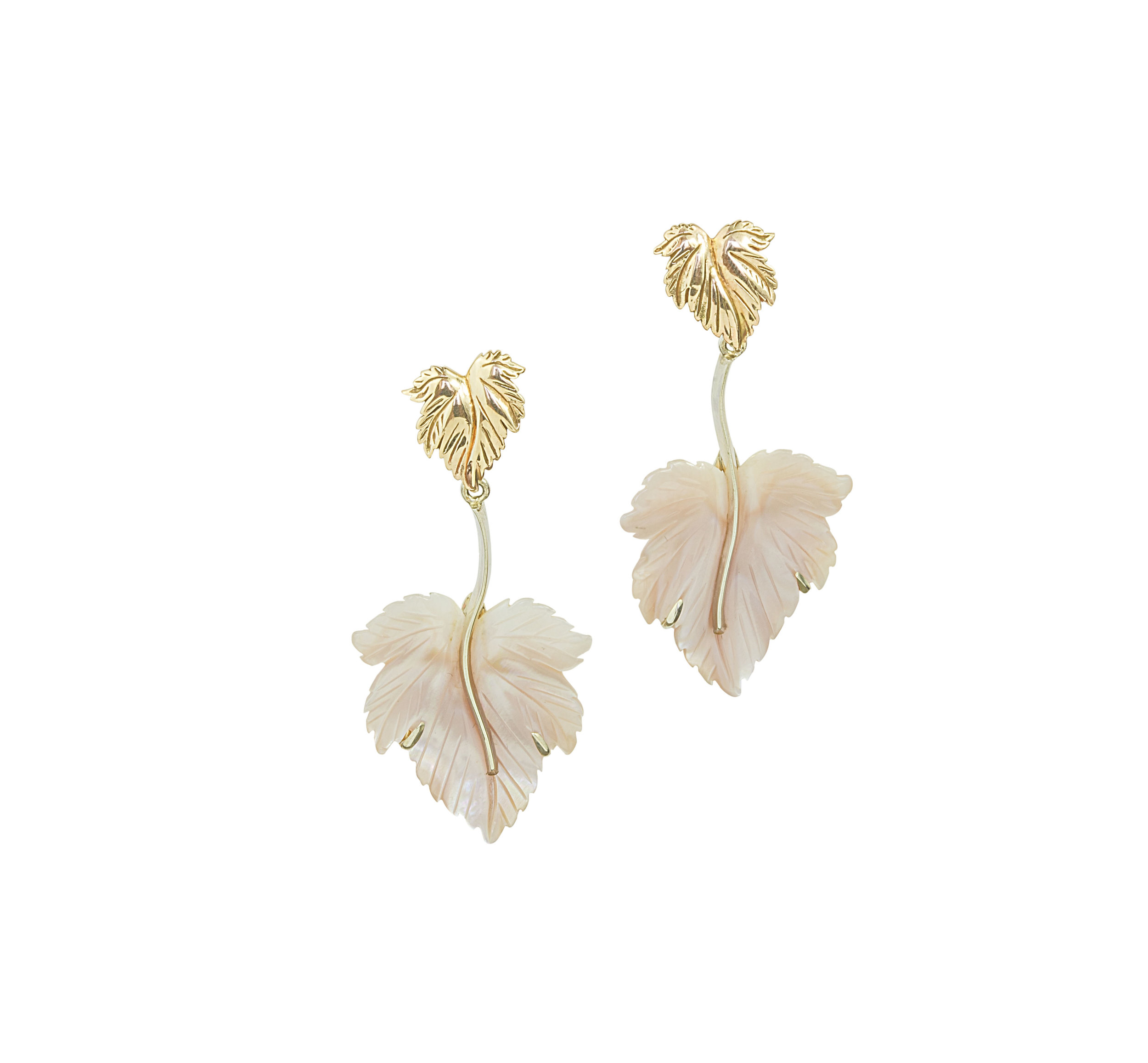 Carved mother of pearl leaves with hand carved and cast into wax rose gold feature at the top