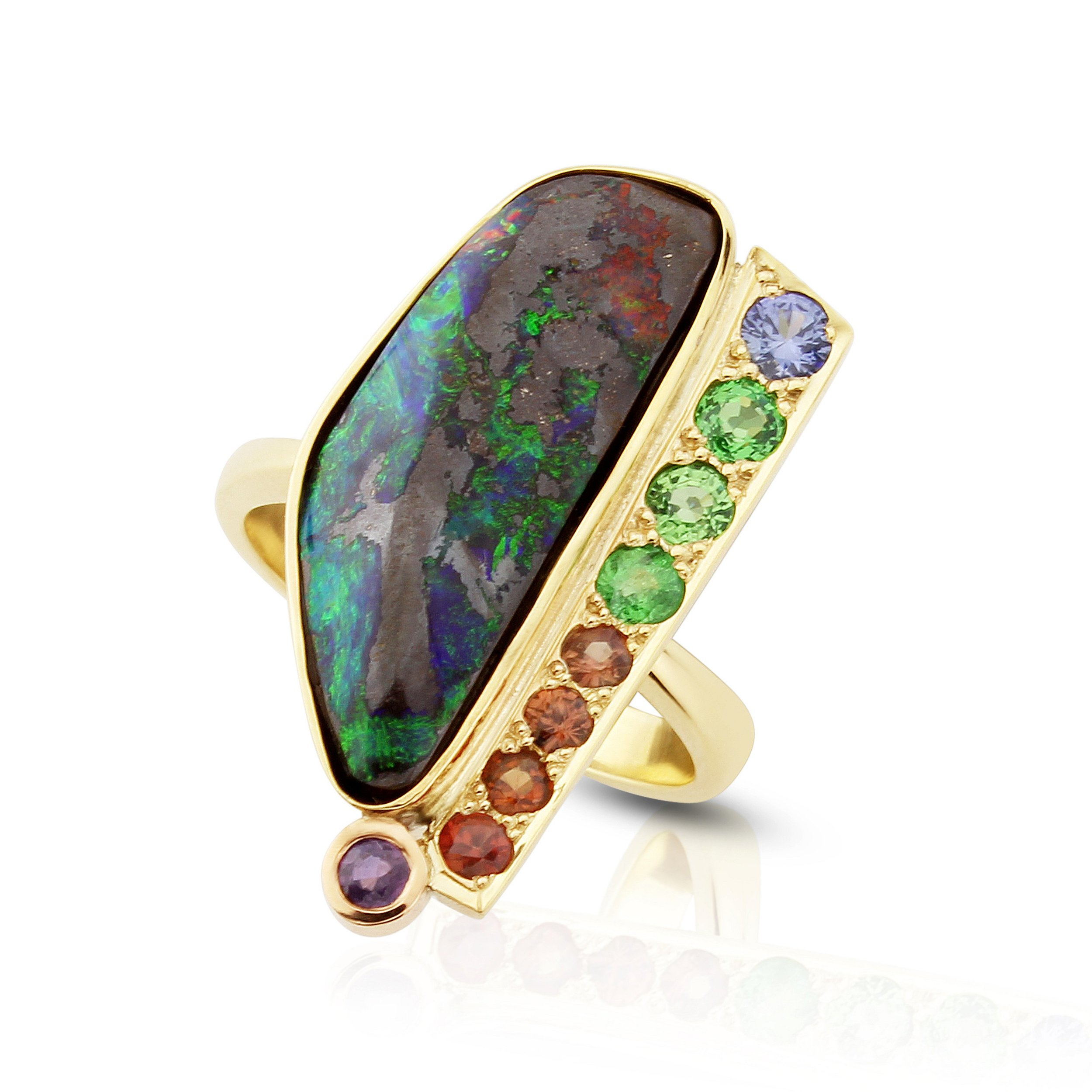 Rainbow of sapphires with tsavorite garnet,and Australian boulder opal in yellow gold.