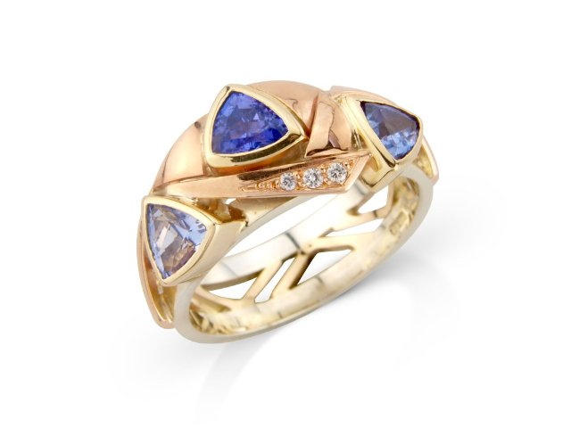 3 colours of tanzanite 3 colours of gold and diamond accents  band style ring
