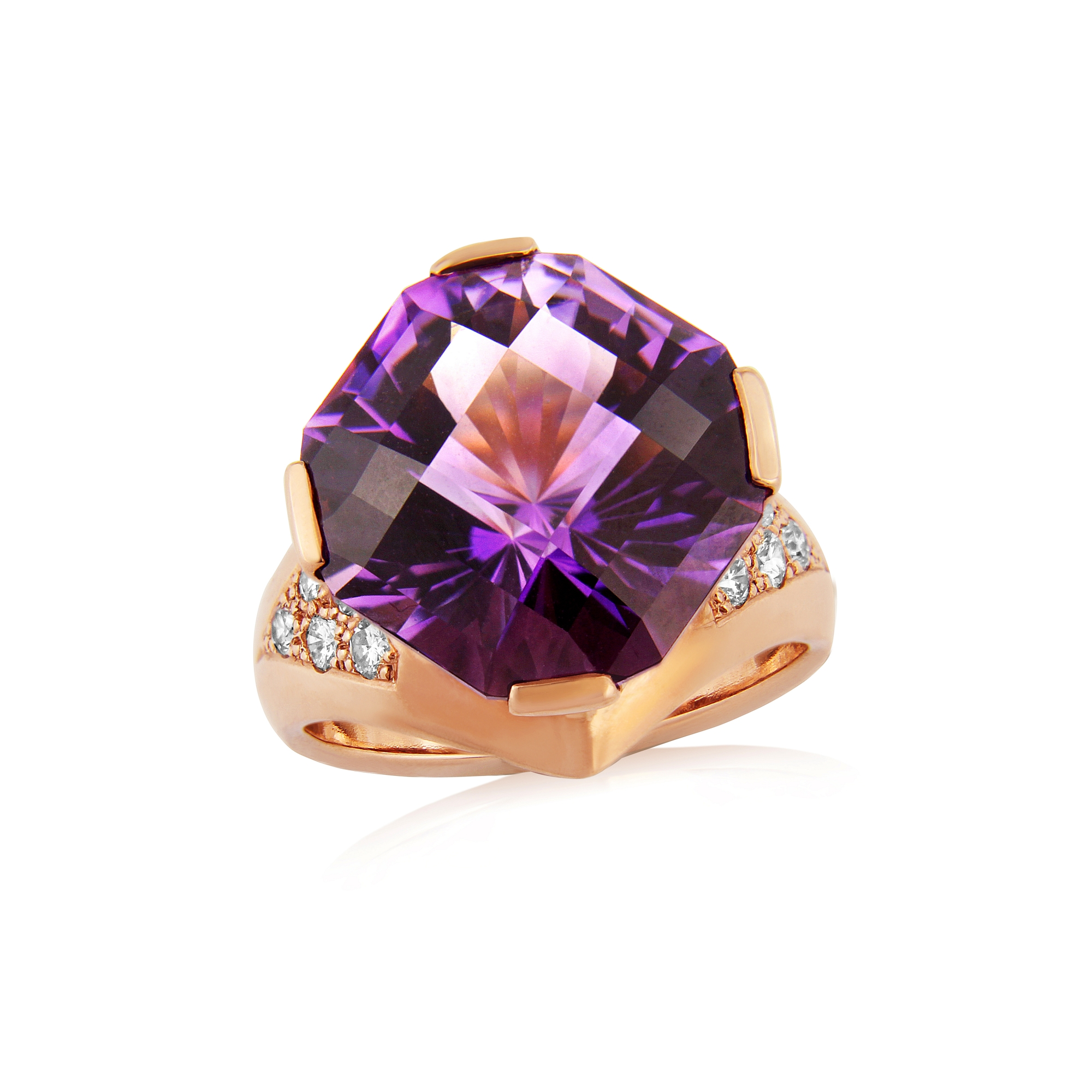 Diamonds and 15ct Amethyst in rose gold, the stone has been diamond cut in a very modern style and this has allowed the stone to really do its thing beautiful.  The ring is hand carved in wax and then cast into rose gold with diamonds set into the shoulders, to finish the design and then we added 2 Diamonds at the bottom of the ring as it comes to a gentle point.  ring size p  THIS RING CANNOT BE SIZED  AVAILABLE