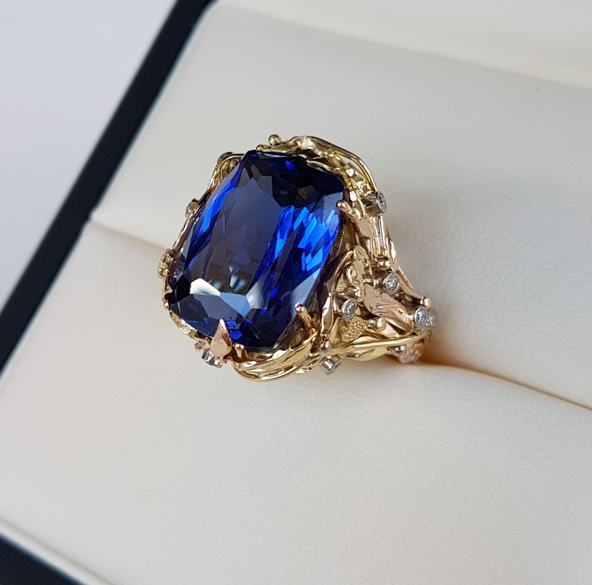 17ct of top colour Tanzanite and diamond ring in 18ct yellow and red gold made in QVJ signiture style this was a real stunner .Clients own Tanzanite