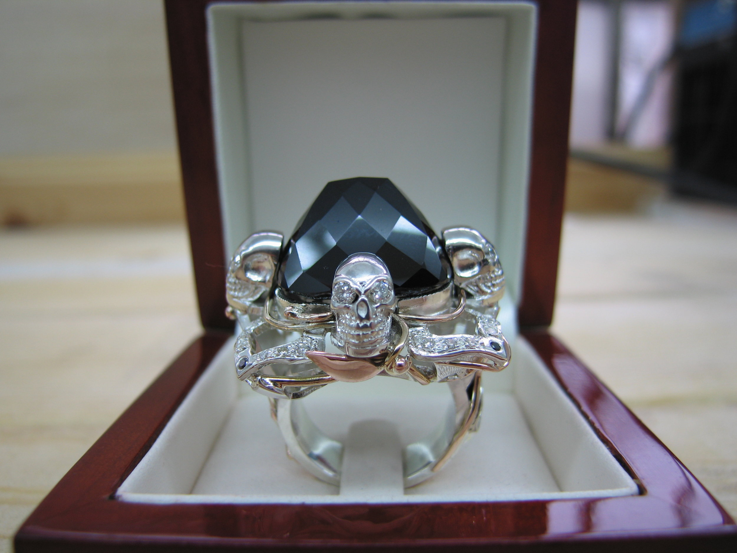 Black gothic bling skulls and chunky was the spec for this ring as you can see we filled the brief in silver and gold with black diamonds white diamonds and a huge black spinel.