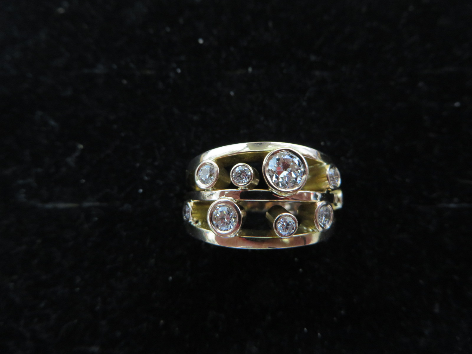 This is an 18ct rose gold hand made mount with the clients own diamonds plus a few extra, stunning ring and very sparkly indeed.