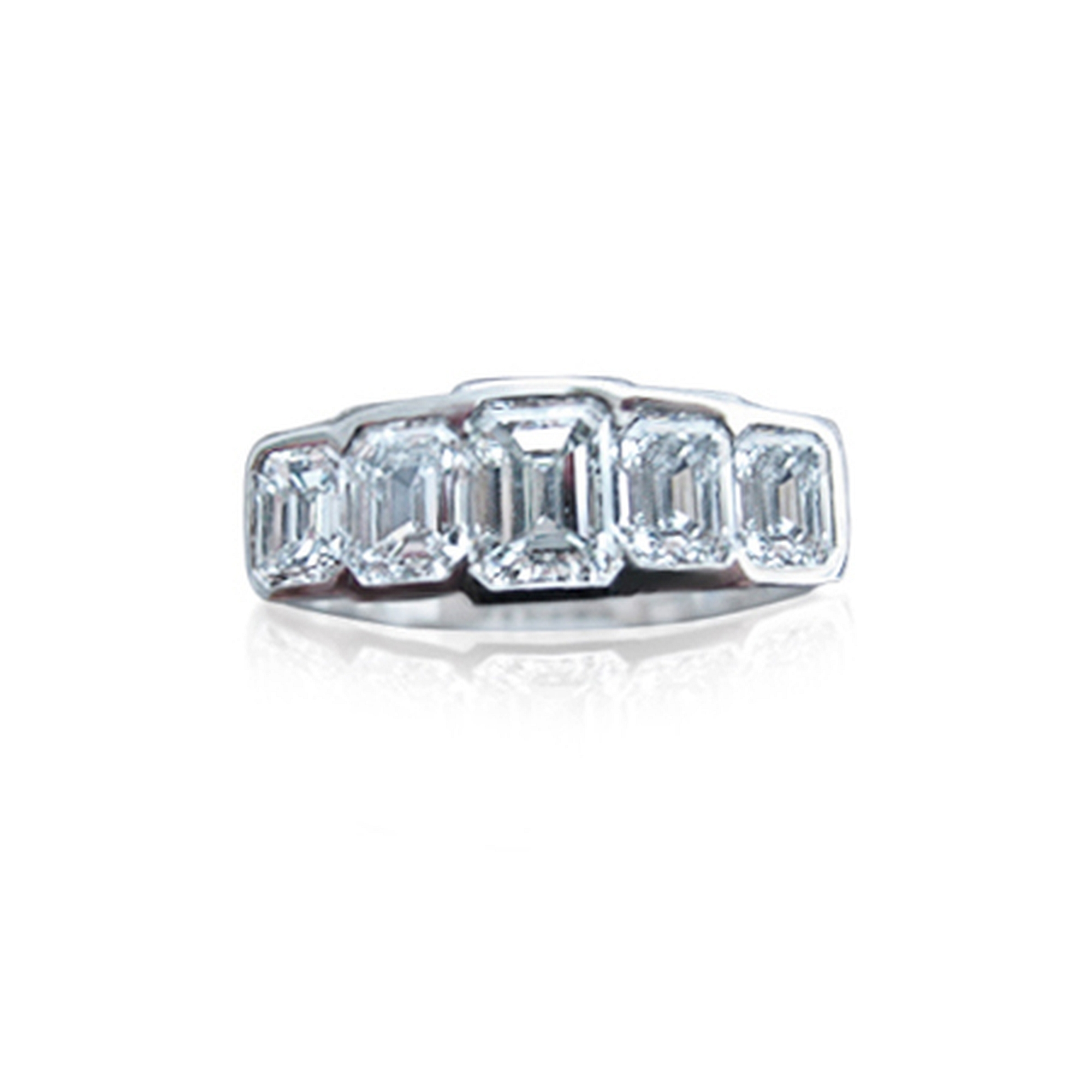 Emerald cut diamonds E colour vvs totalling 2.5cts in 18ct white gold this was challenging, all the stones save two were the clients own.