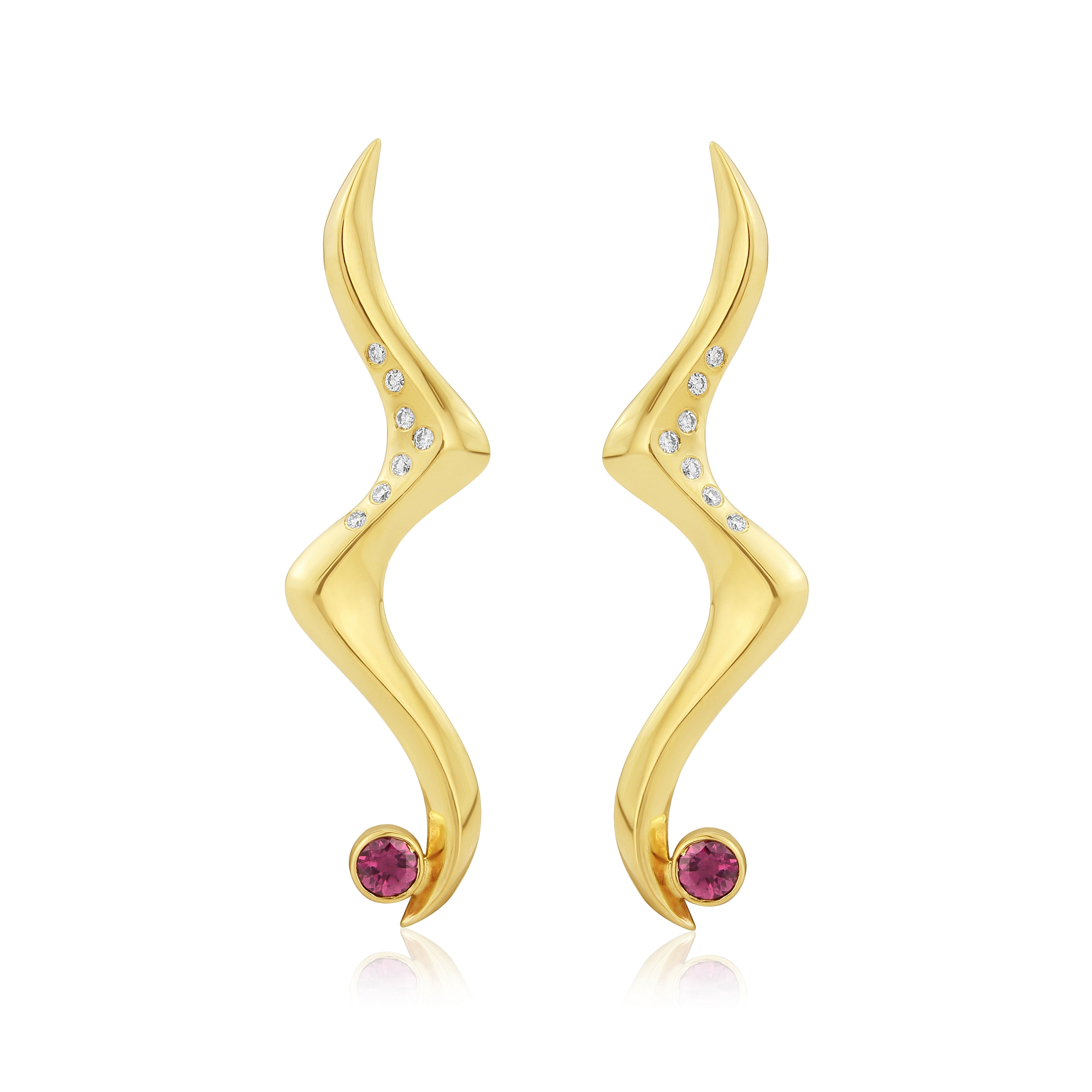 Long dress earrings originally carved in wax then cast in 9ct gold and set with Garnets and Diamonds