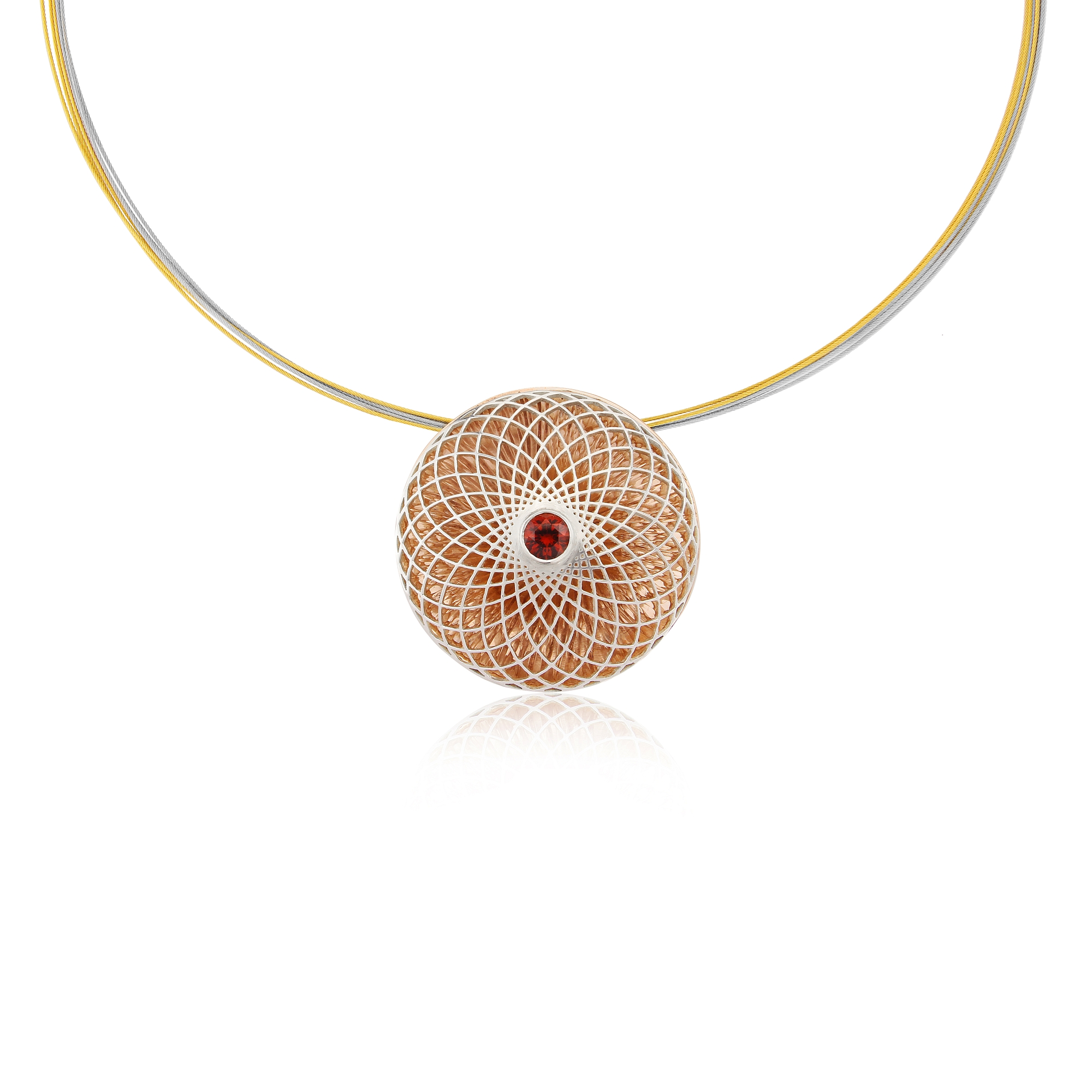 Second spiro pendant featuring a diamond cut garnet all made in 935 quality silver with gold vermeil back