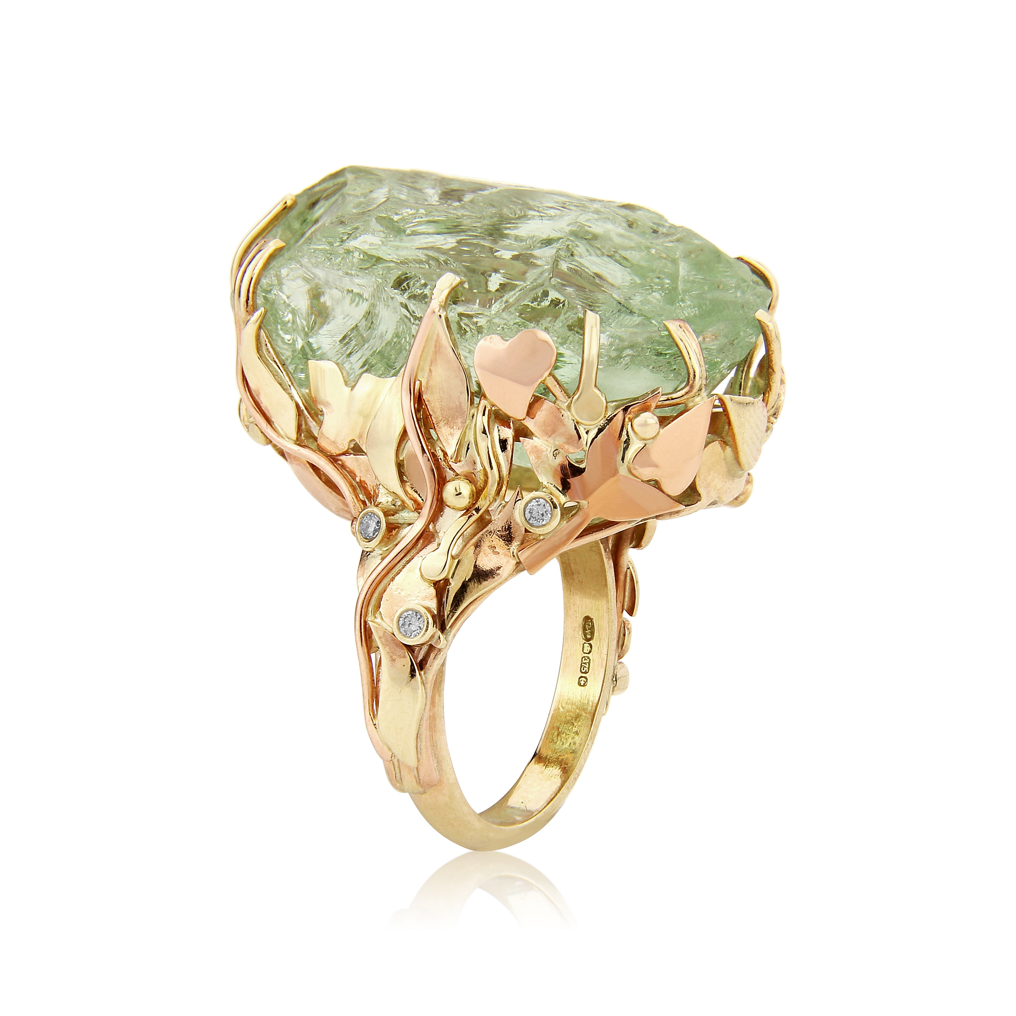 Large Green Prasiolite and diamond dress ring mounted in 9ct yellow and red gold featuring QVJ,s signature leaves.