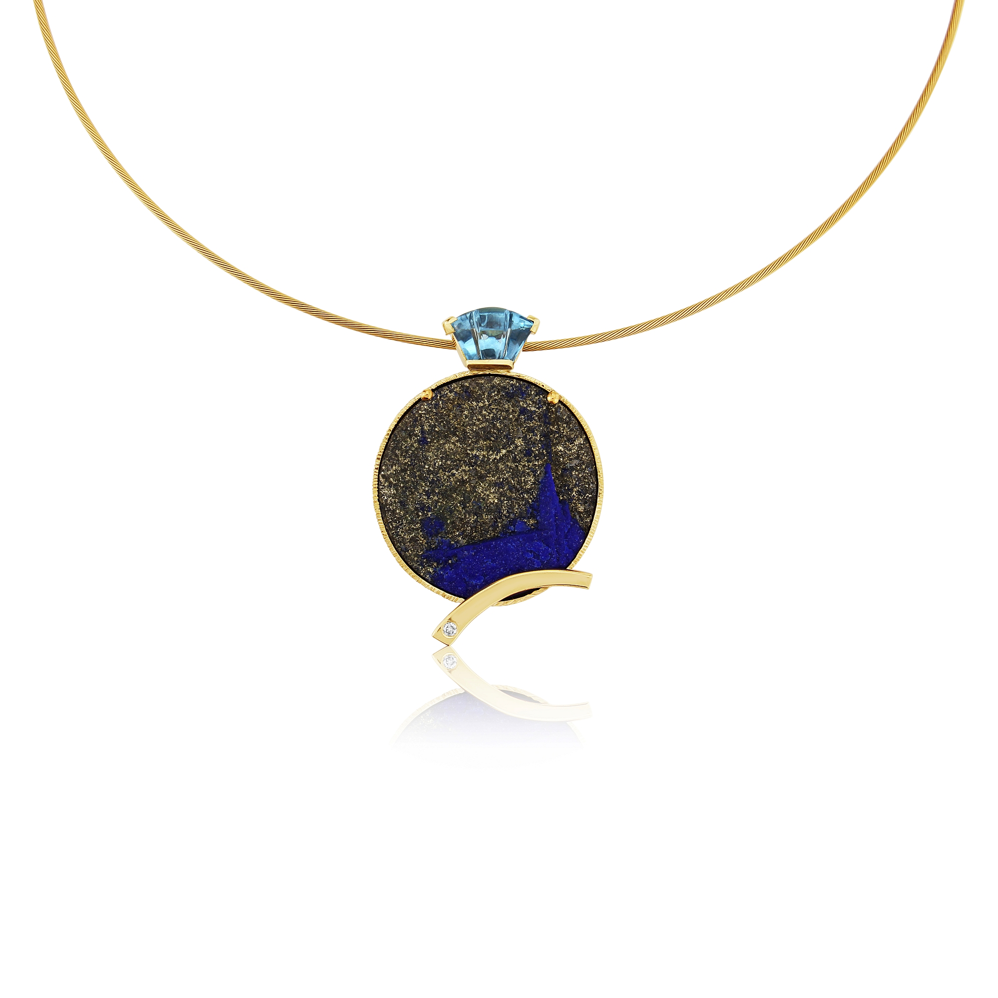 9ct Lapis in its rough state love the pyrite against the vibrant blue in this ,with a carved blue topaz as the bail with a diamond in the flash of gold .